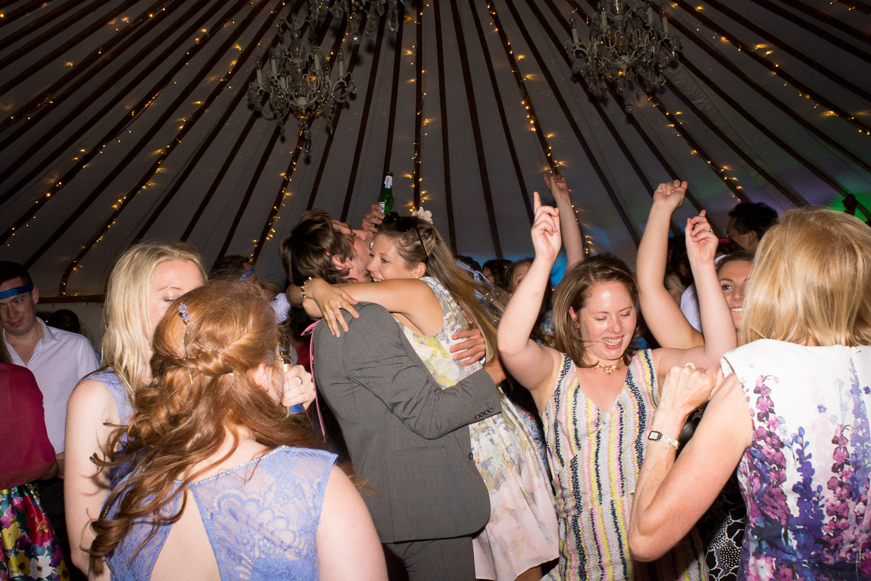 big hugs on the dancefloor at wedding yurts wedding in leicestershire