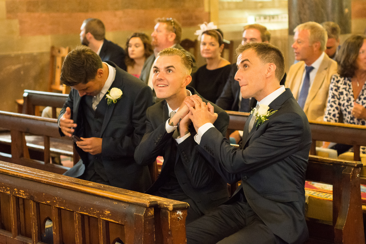 The groom and his brother knock one out of the park at All saints church in Torquay, Devon