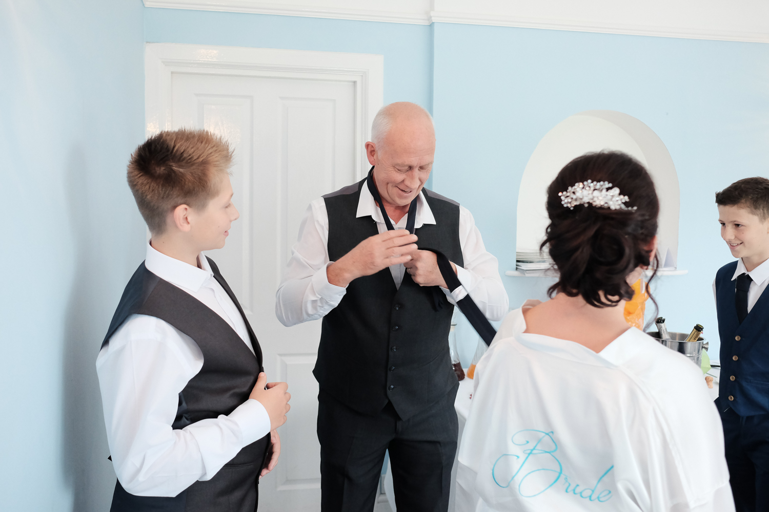 man helping the boys with their ties at The Lord Haldon Hotel in Devon