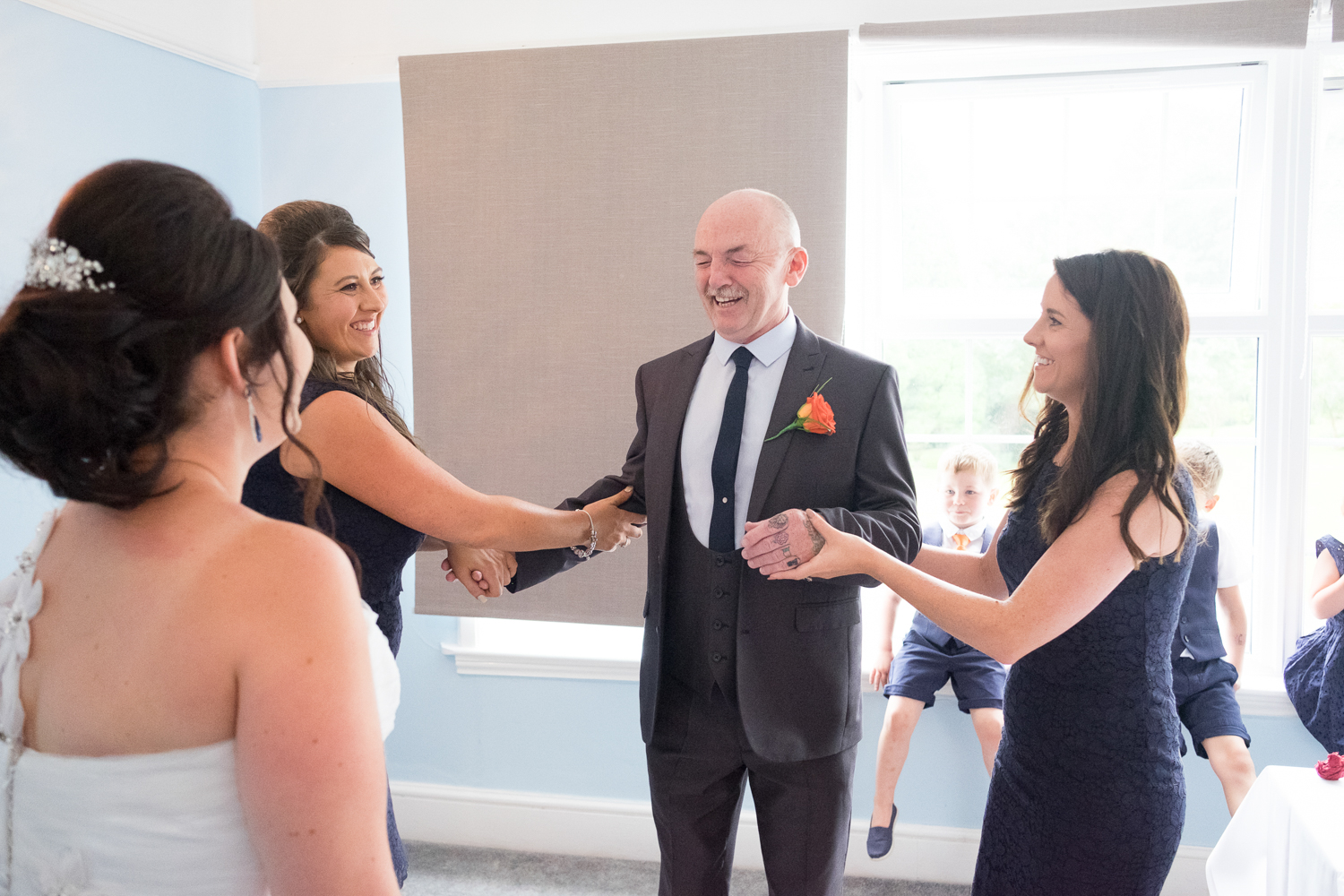 father of the bride closes his eyes ready to see his daughter in her dress at The Lord Haldon Hotel in Devon