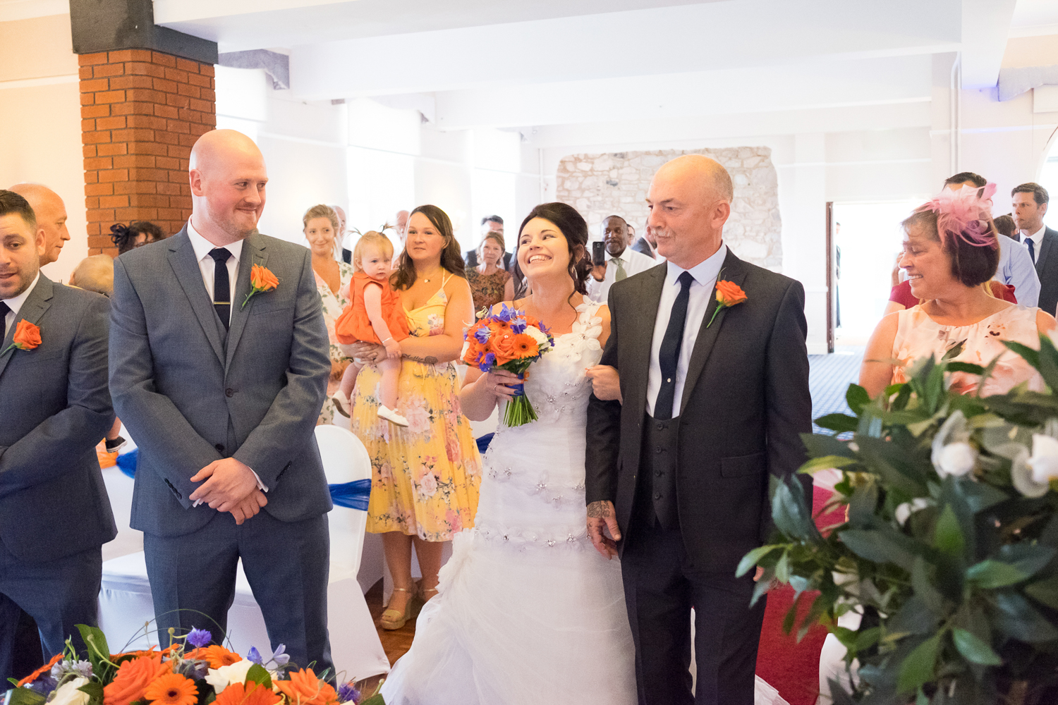 walking down the aisle at The Lord Haldon Hotel in Devon