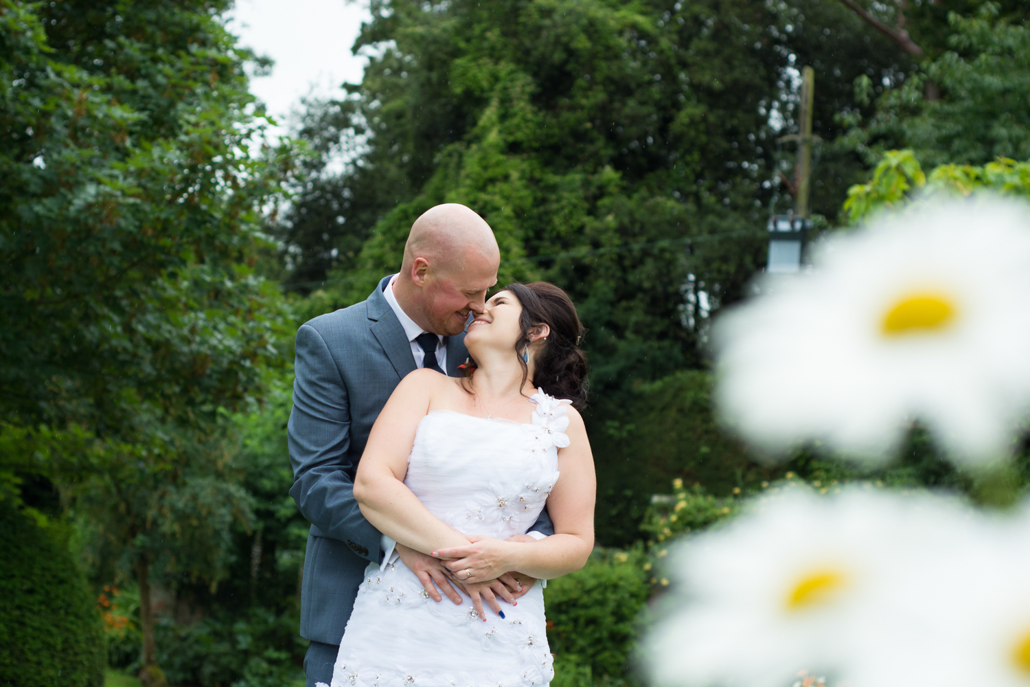 bride, groom and giant daisies at The Lord Haldon Hotel in Devon
