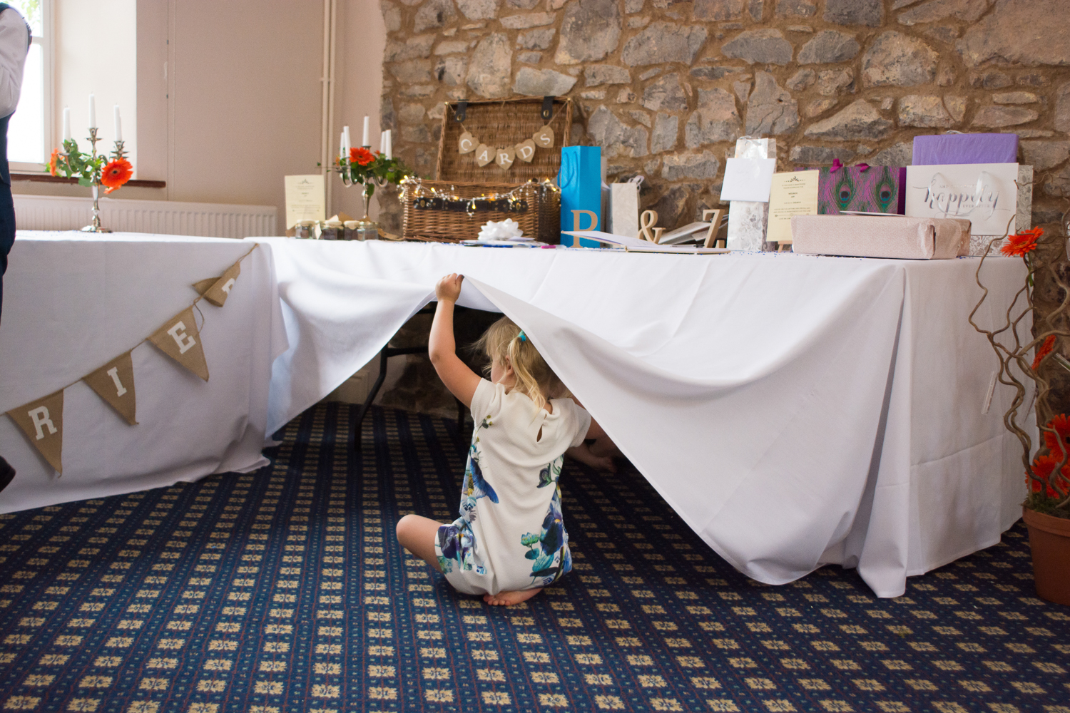 children play under the table at The Lord Haldon Hotel in Devon