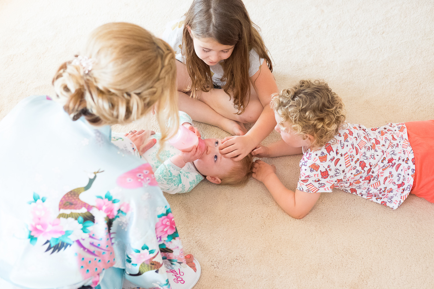 mum and cousins settle baby on the floor in woolacombe devon