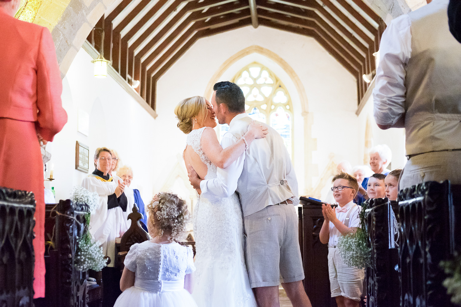 bride and groom first kiss in st mary's church in woolacombe