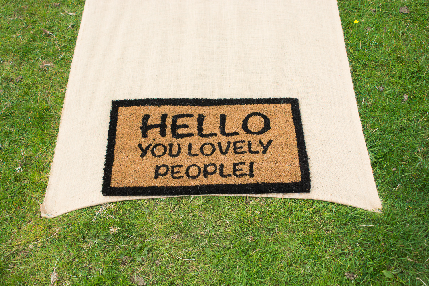 outside door mat reads, Hello you lovely people in woolacombe