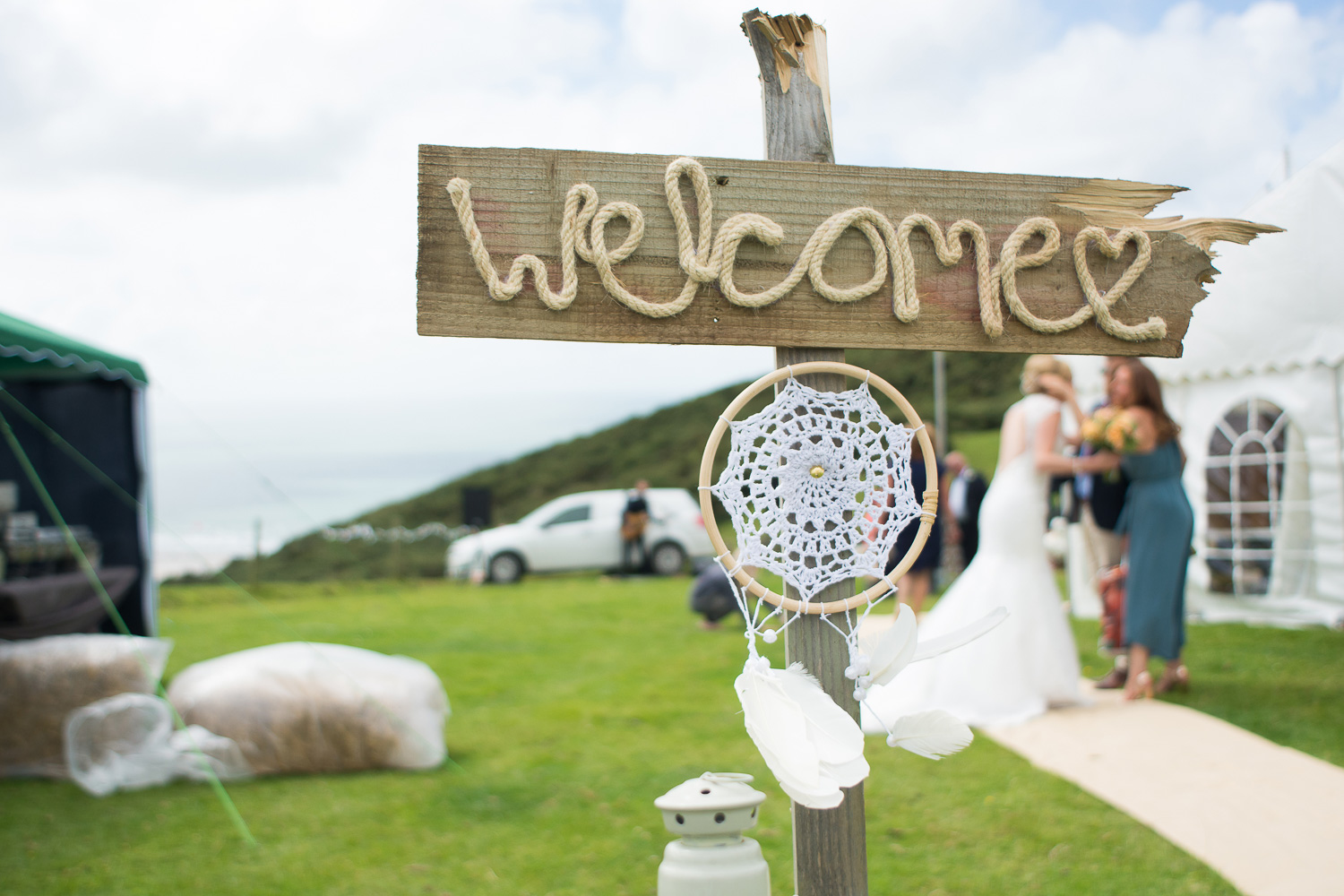 wedding welcome sign and dream catcher at woolacombe festival wedding