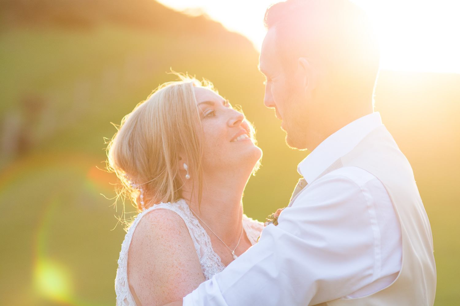 bride and groom share a moment in the beautiful sunset at their woolacombe festival wedding