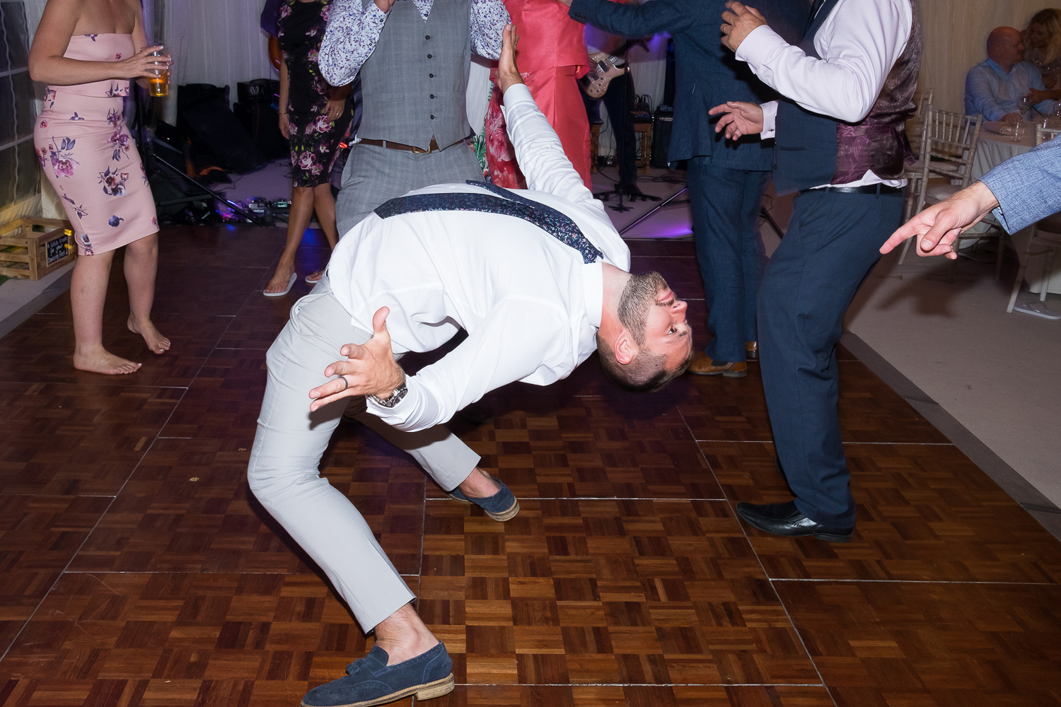 crazy shapes on the dancefloor at woolacombe wedding