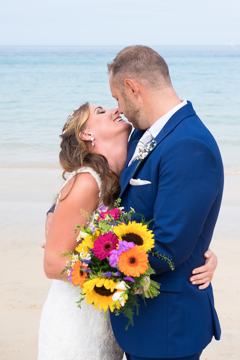 Bride and groom about to kiss on the beach in St Ives in Cornwall