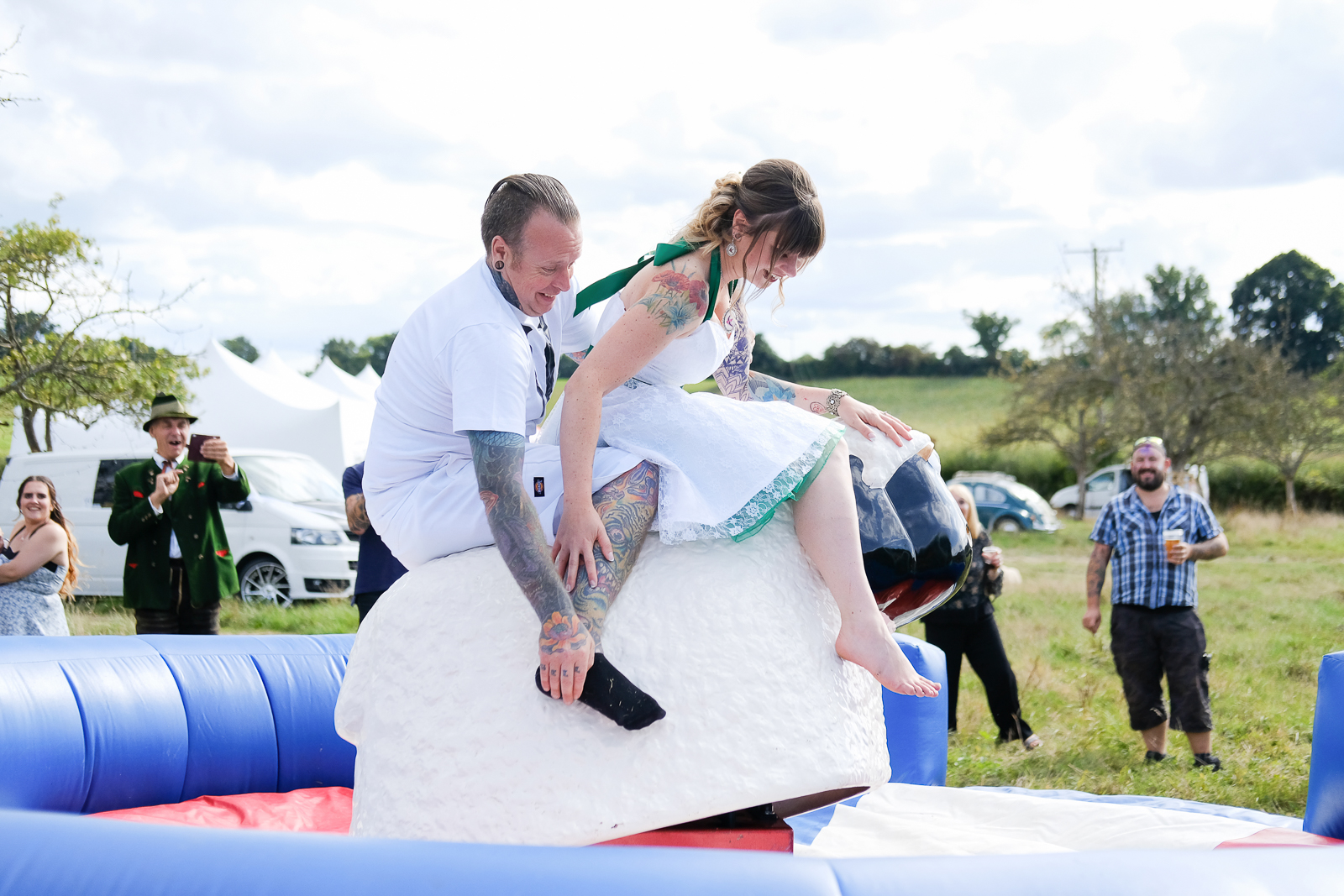 Bride and groom on rodeo sheep at their Exmouth wedding
