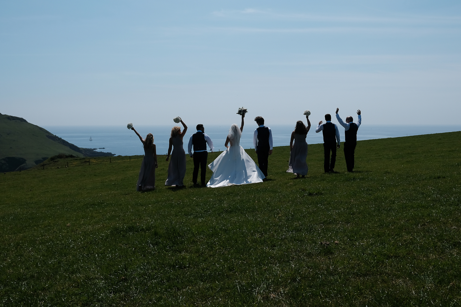 fun group photo of the bridal party at new barton barns in devon