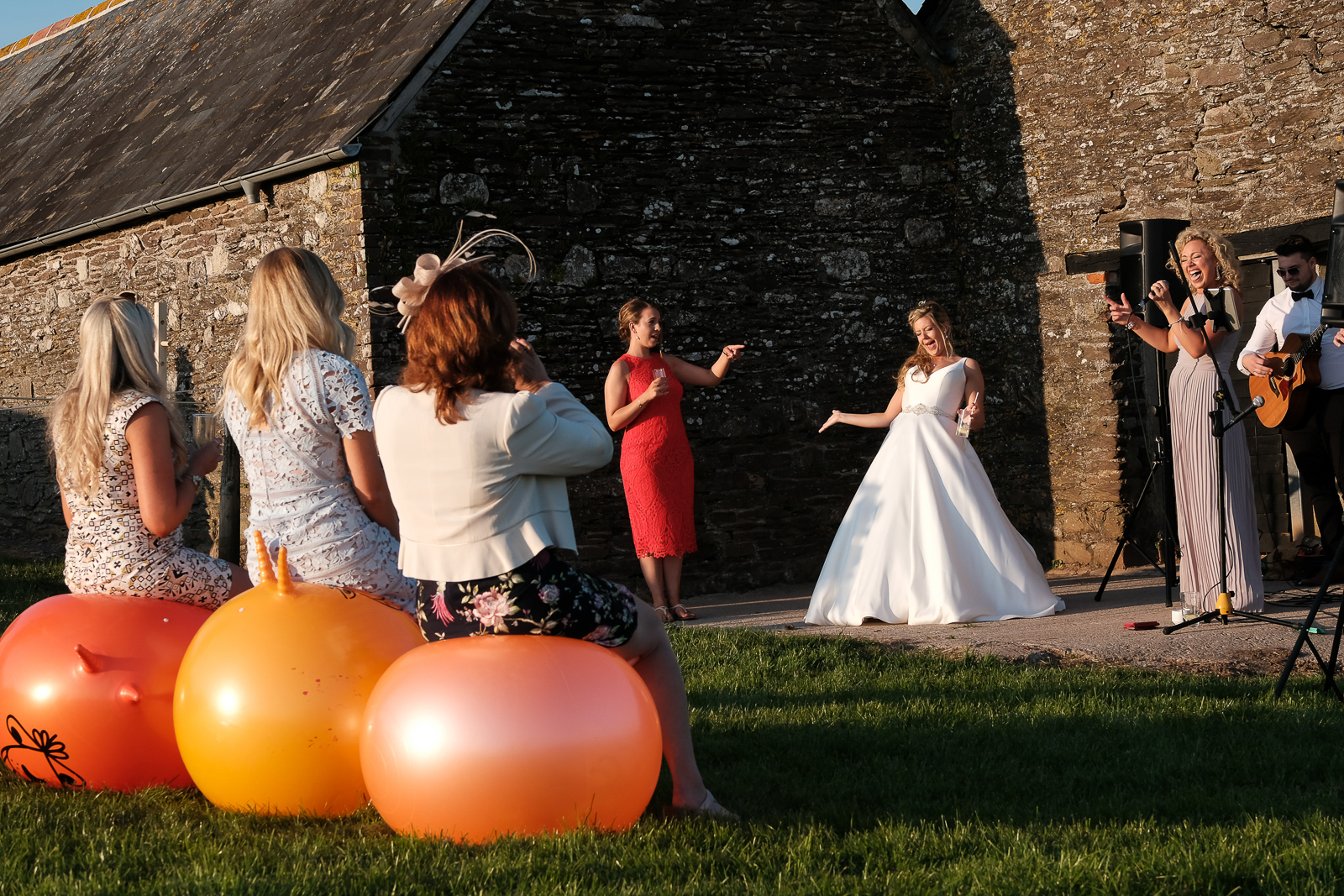 Space hoppers and live music at claire and tim's New Barton Barns wedding in Devon
