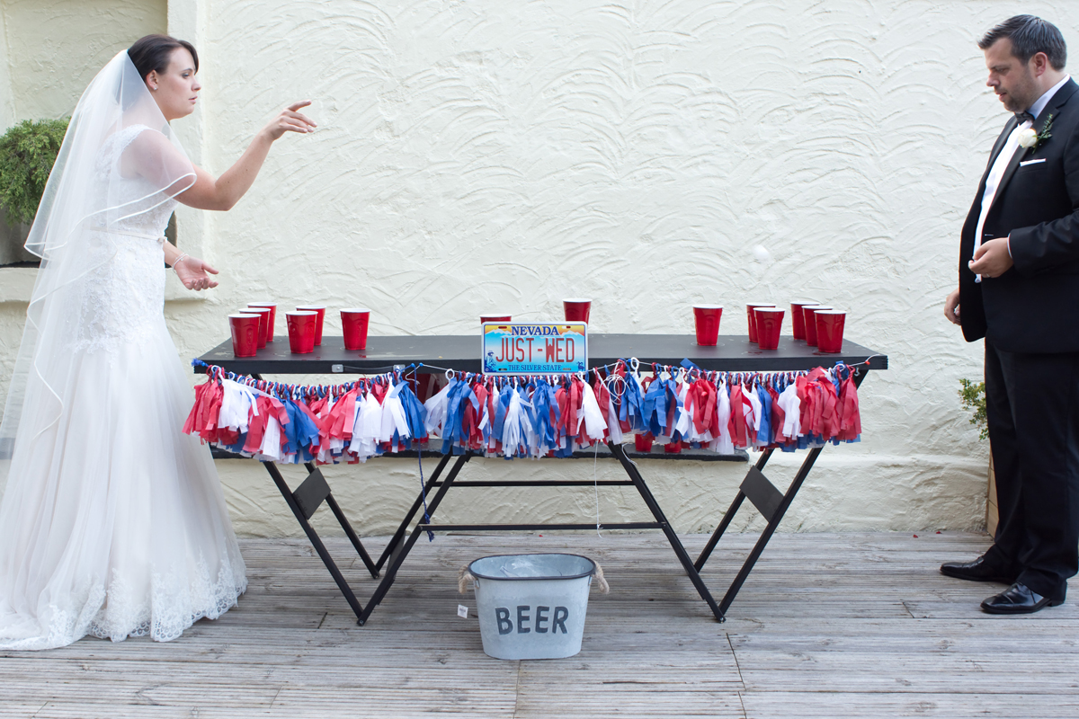 Bride and Groom Playing Beer pong at their wedding at The Bickley Mill in Devon