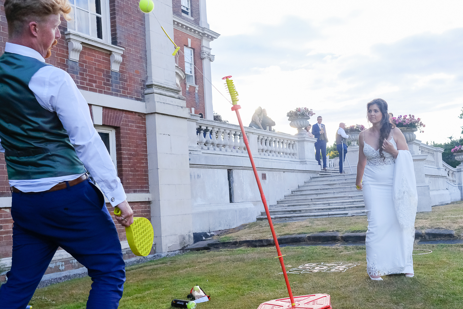 Bride and Groom Playing swingball at their wedding in Birmingham