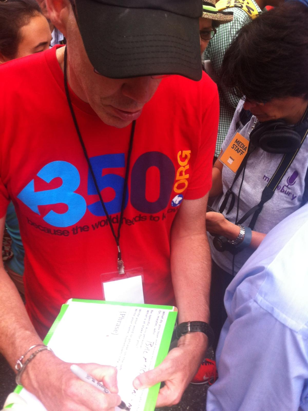 Bill McKibben makes a Climate Ribbon at the People's Climate March.