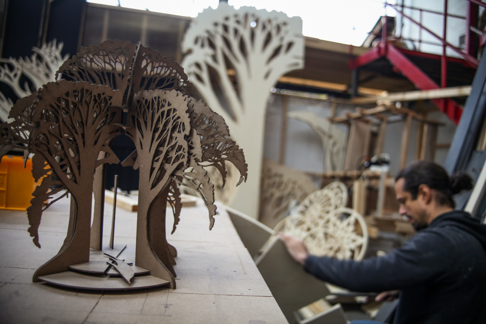 Tree model, with Gan Golan working on the base of the larger tree