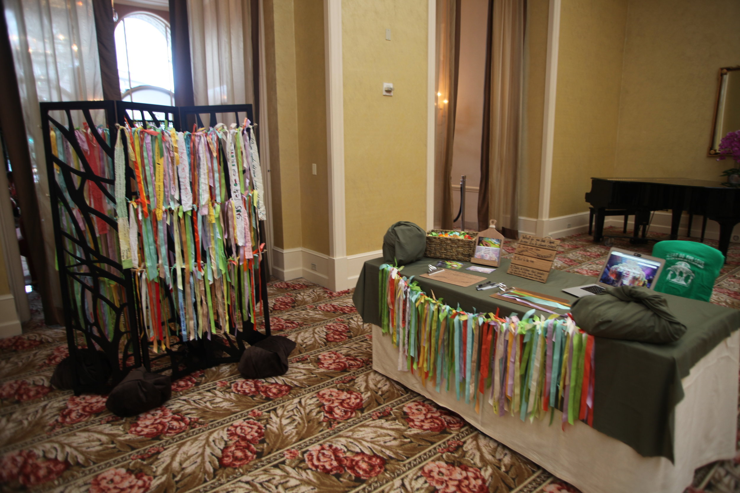 The Climate Ribbon Tree as a folding screen shape, and the accompanying table for people to make their own ribbons to add.