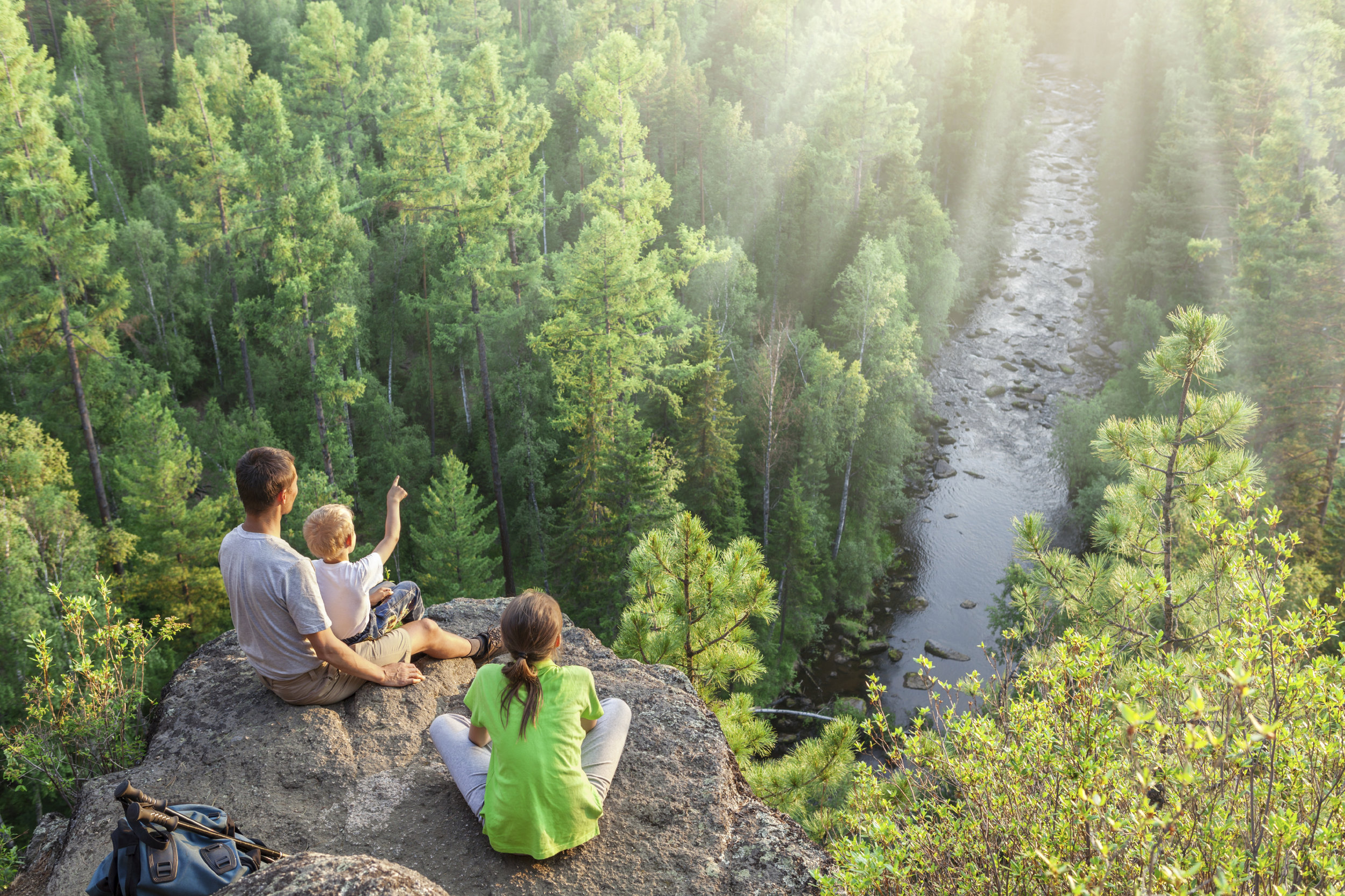 Family-of-backpackers-look-at-beautiful-view-000044064078_Large.jpg