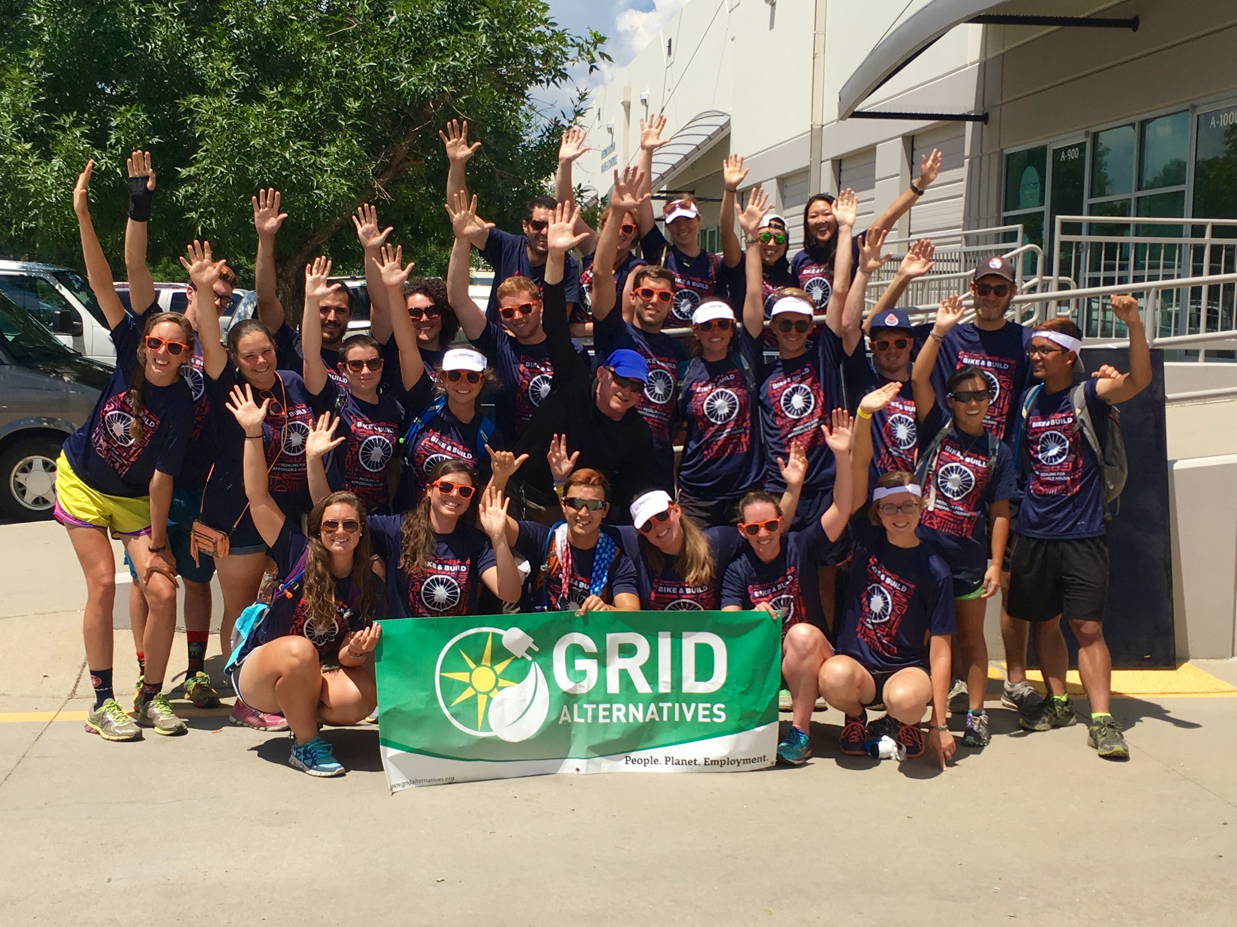 """Gathering with """"Bike and Build"""" outside the GRID, Colorado warehouse."""