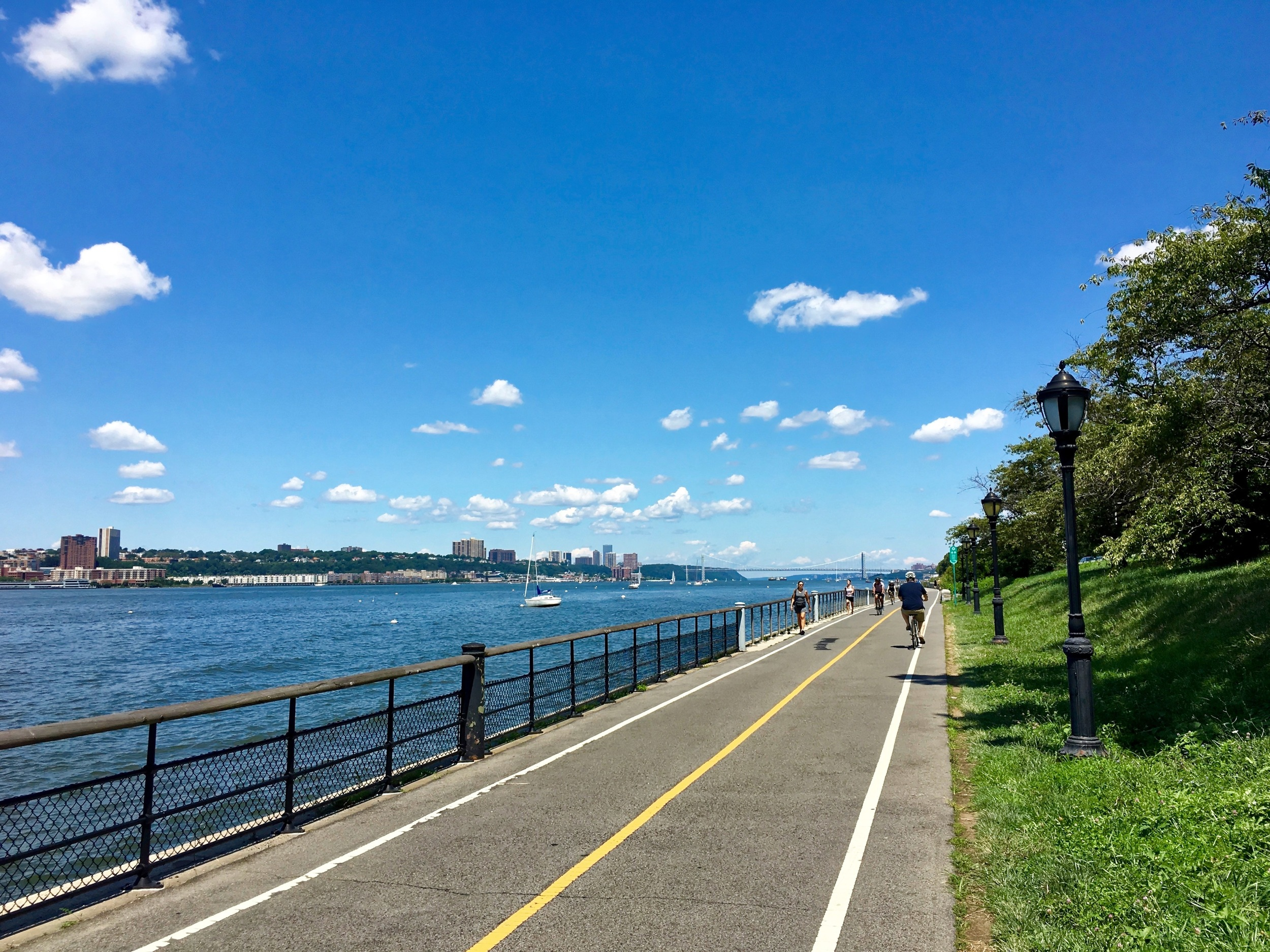 The NYC West Side Bike Path that runs north and south along the Hudson River. The bridge in the distance is the George Washington. I took this shot as I biked north to my apartment in Washington Heights on the day I returned.