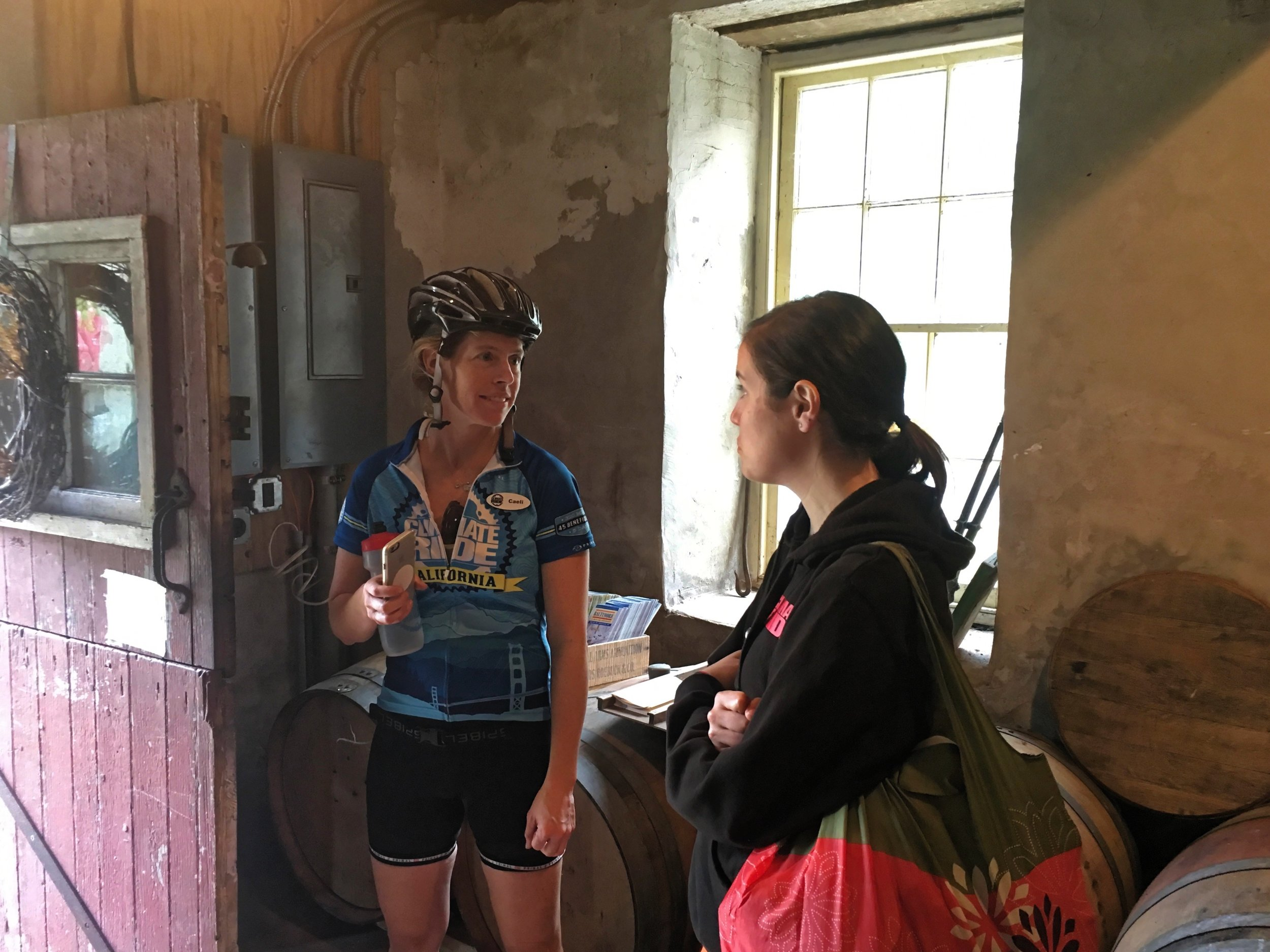 Caeli from Climate Ride talking to a rider