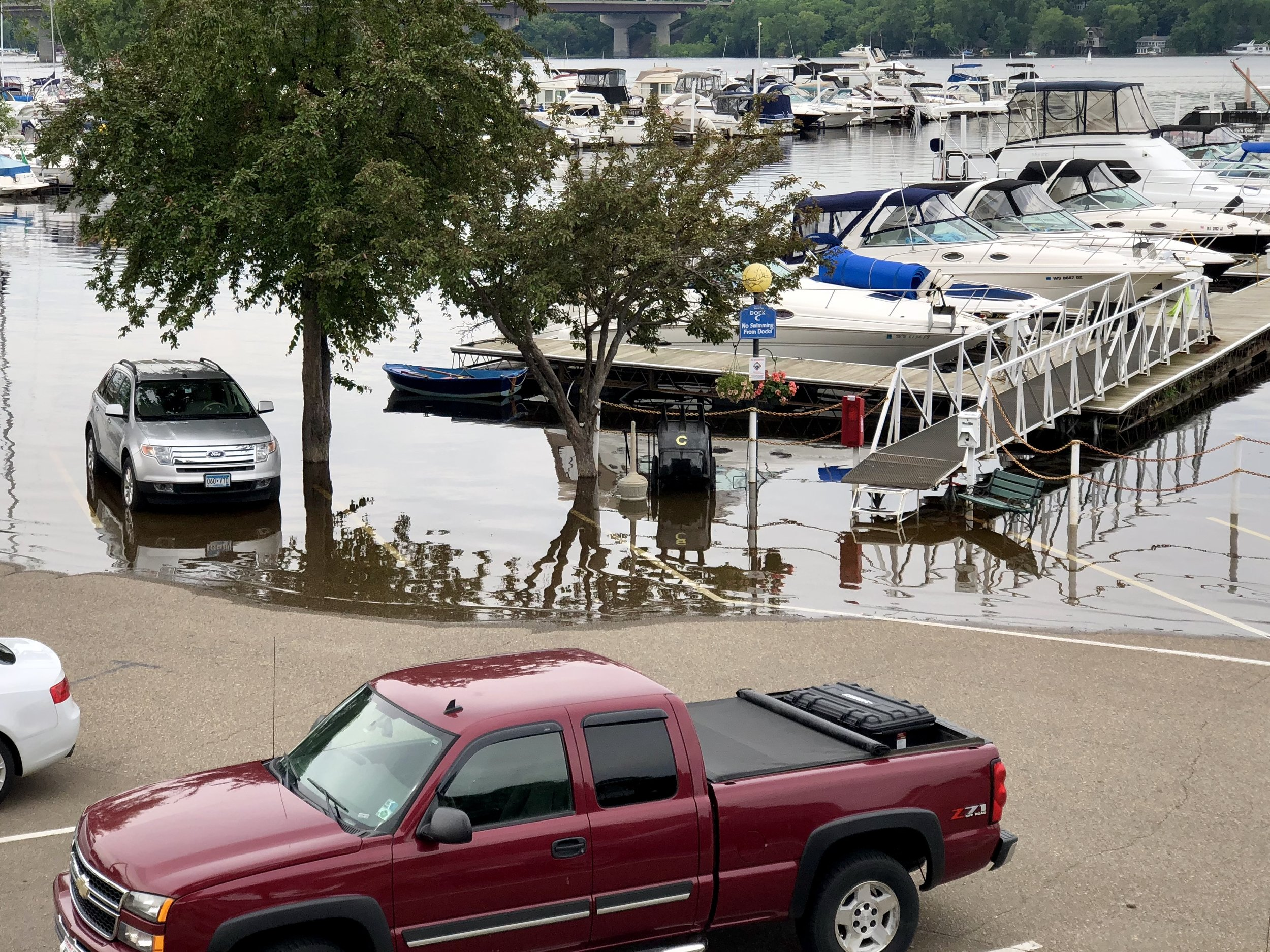 The waterline encroaches on a parking lot on the St. Croix River East of Minneapolis.