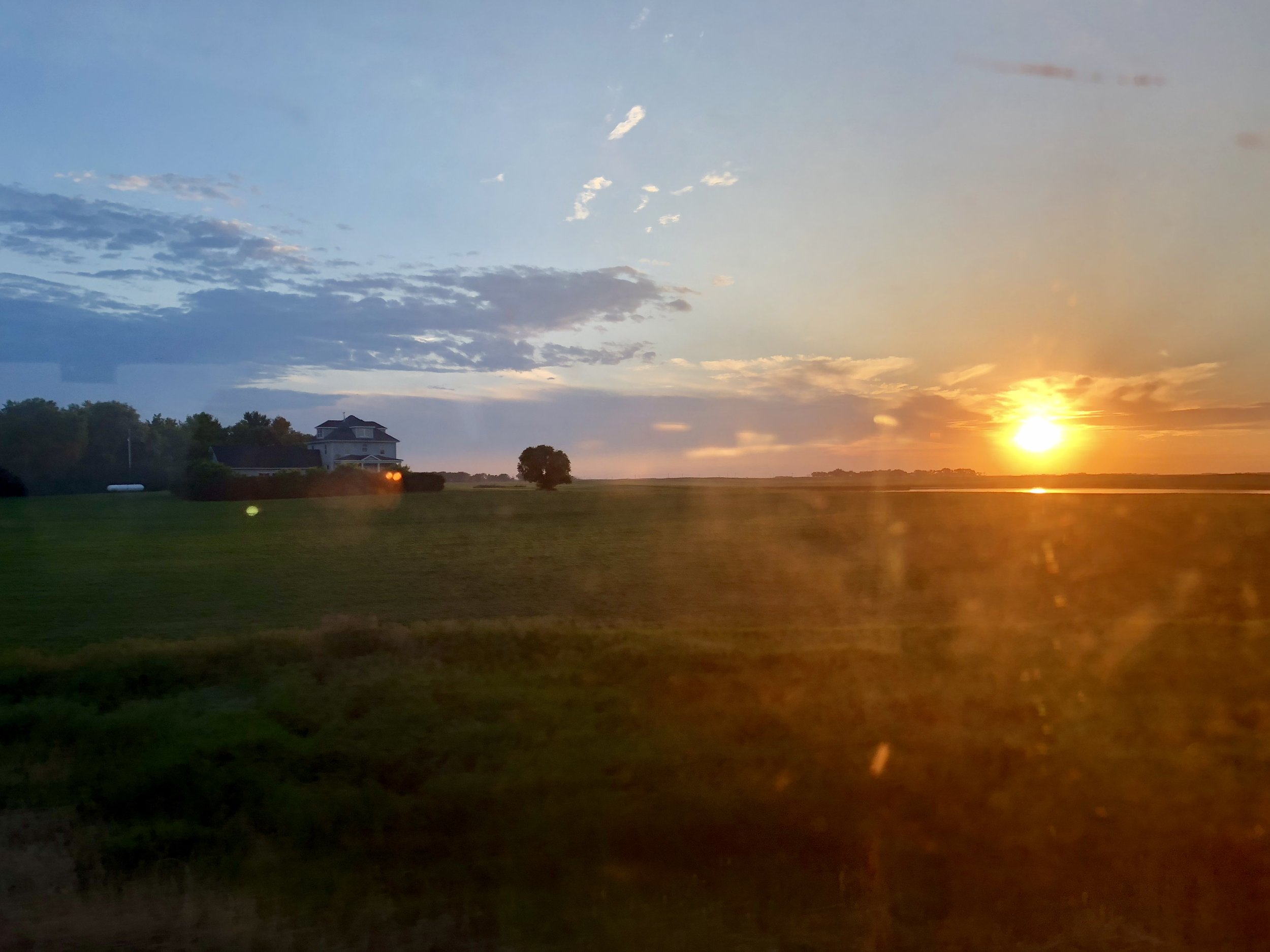 Minnesota sunset from the window of the train.