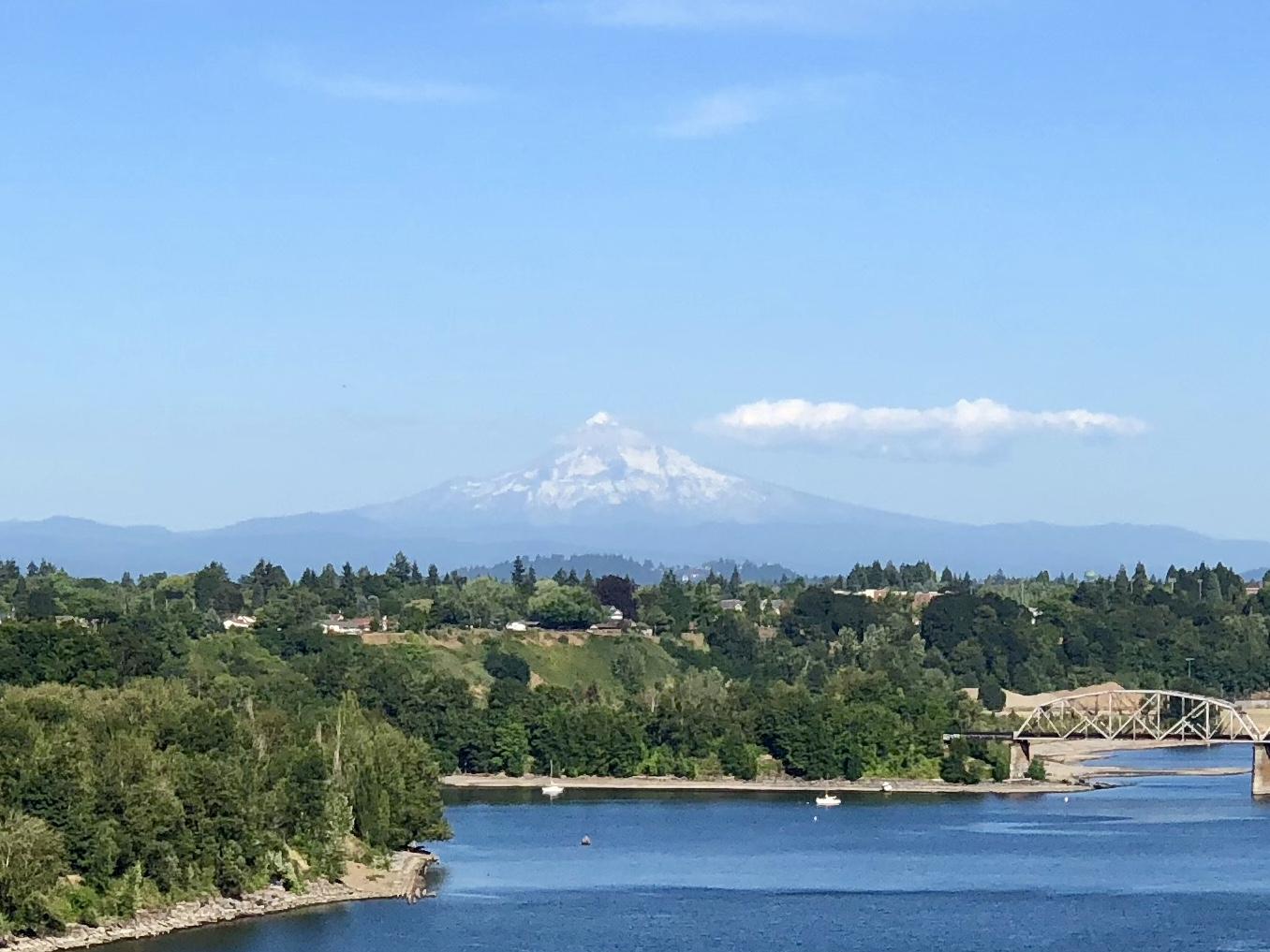 Mt. Hood looms in the distance off the Saint John's bridge across the Willamette River.