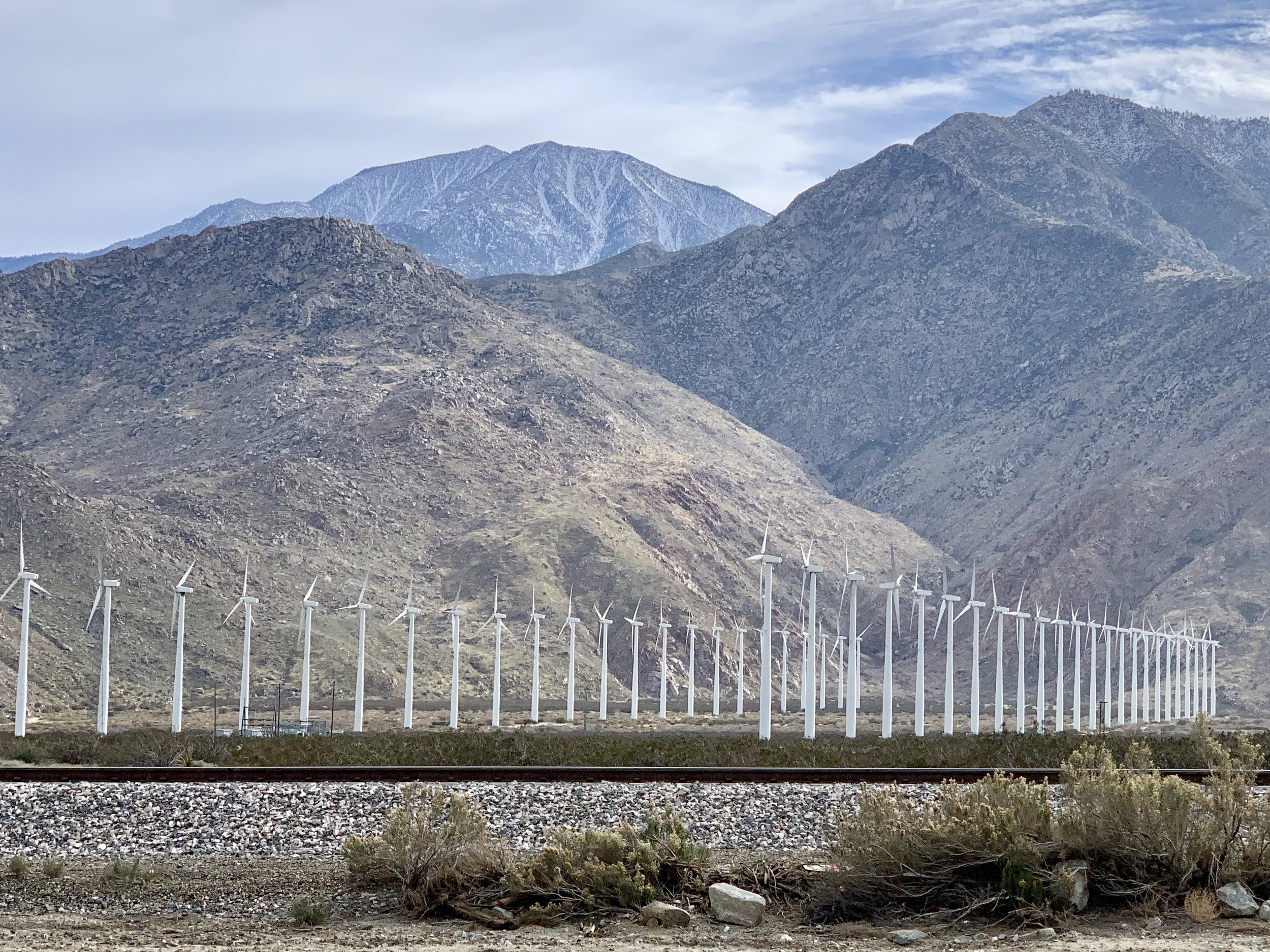 The pass from Banning to Palm Springs is quite windy and there are hundreds of wind turbines along the way. They can be attractive, and far less noisy than traditional oil wells.