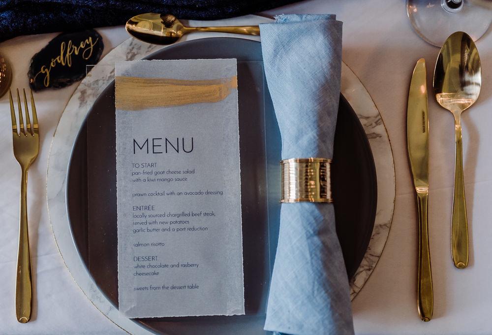 Acrylic and vellum wedding menu with gold leaf by Studio Oudizo, Cheltenham