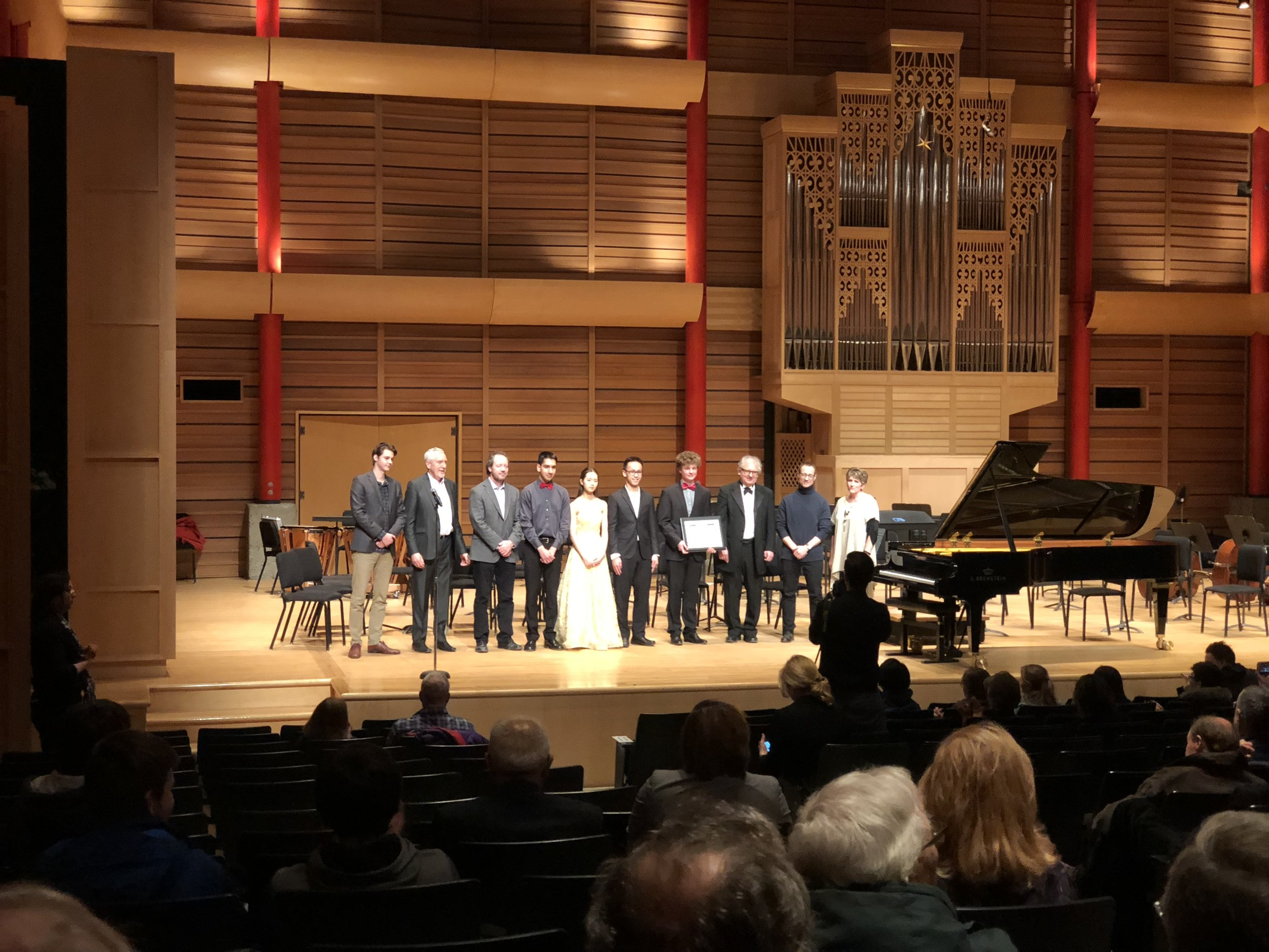 From left to right: Karl Hirzer (Resident Conductor of the CPO and Jury), Paul Dornian (President & CEO of the CPO and Jury), Brad Mahon (Director, MRU Conservatory), Daniel Dastoor (violin), Sua Kwoun (cello), Cameron Wong (oboe), Daniel Szefer (piano), Edmond Agopian (Professor,Conductor and Violinist), Bruce Barton (SCPA Professor & Director), Joelle Welling (SCPA Chair & Senior Instructor).
