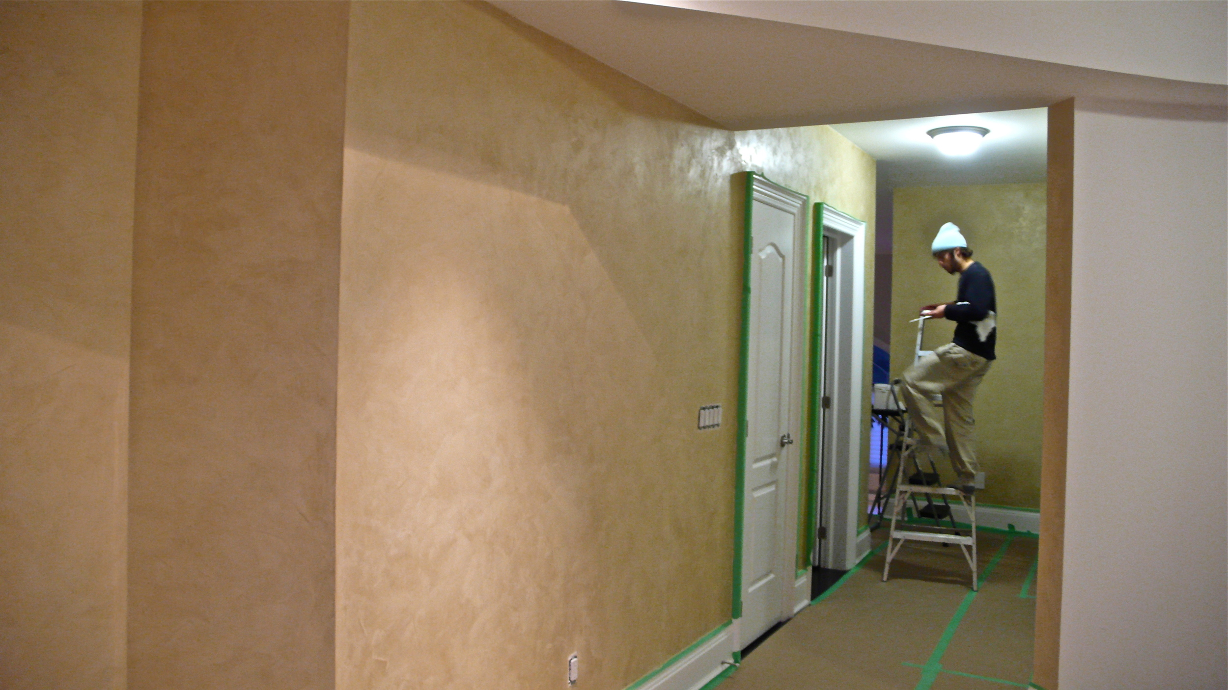 When the plaster has dried, we burnish it and apply a protective wax topcoat.