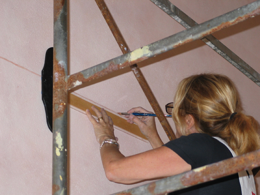 Painting a pinstripe by hand with just a ruler and artists brush.