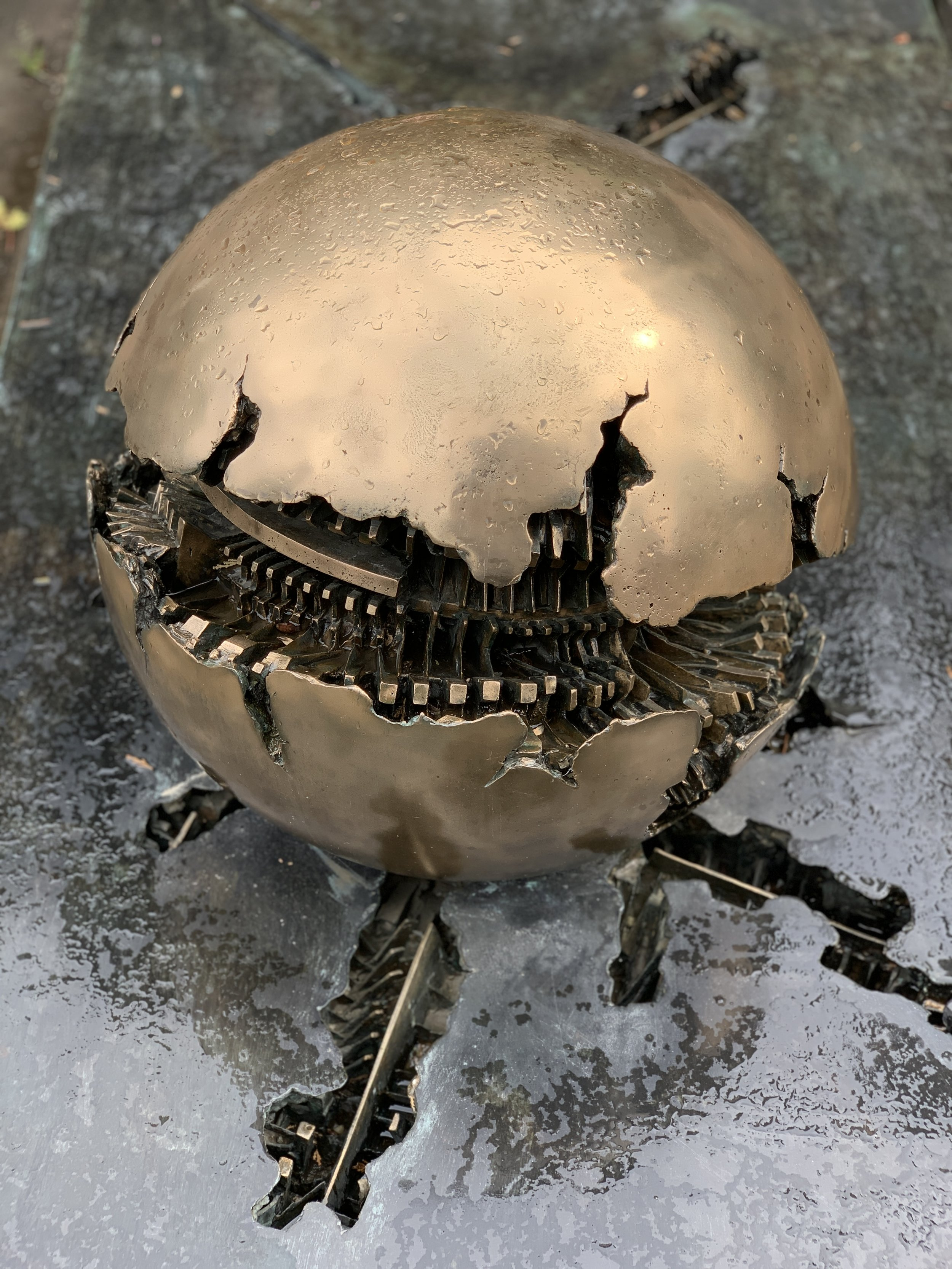 A tombstone, if it can be called that, designed by Arnaldo Pomodoro at Il Cimitero Monumentale.