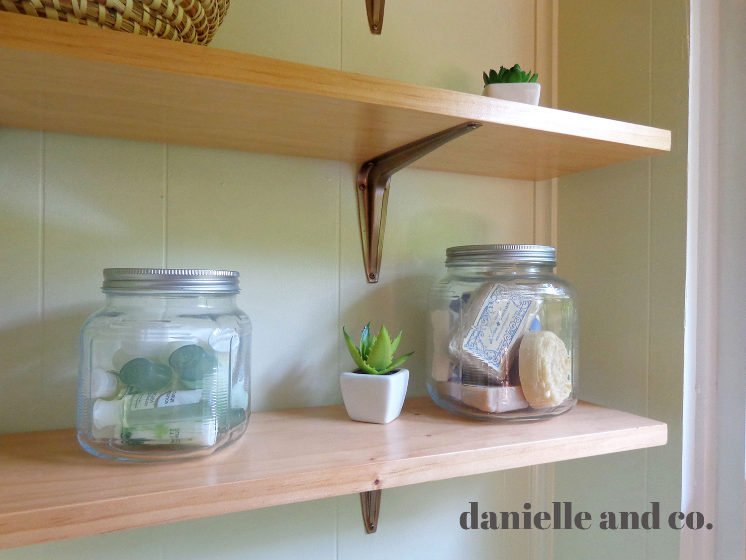 Accessorizing bathroom shelves on a budget, from danielleandco.com
