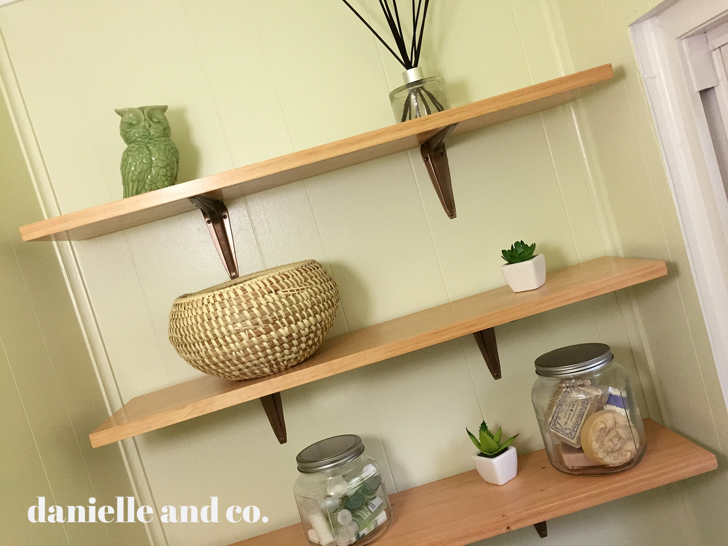 DIY bathroom shelving = so much storage, and pretty too! From danielleandco.com