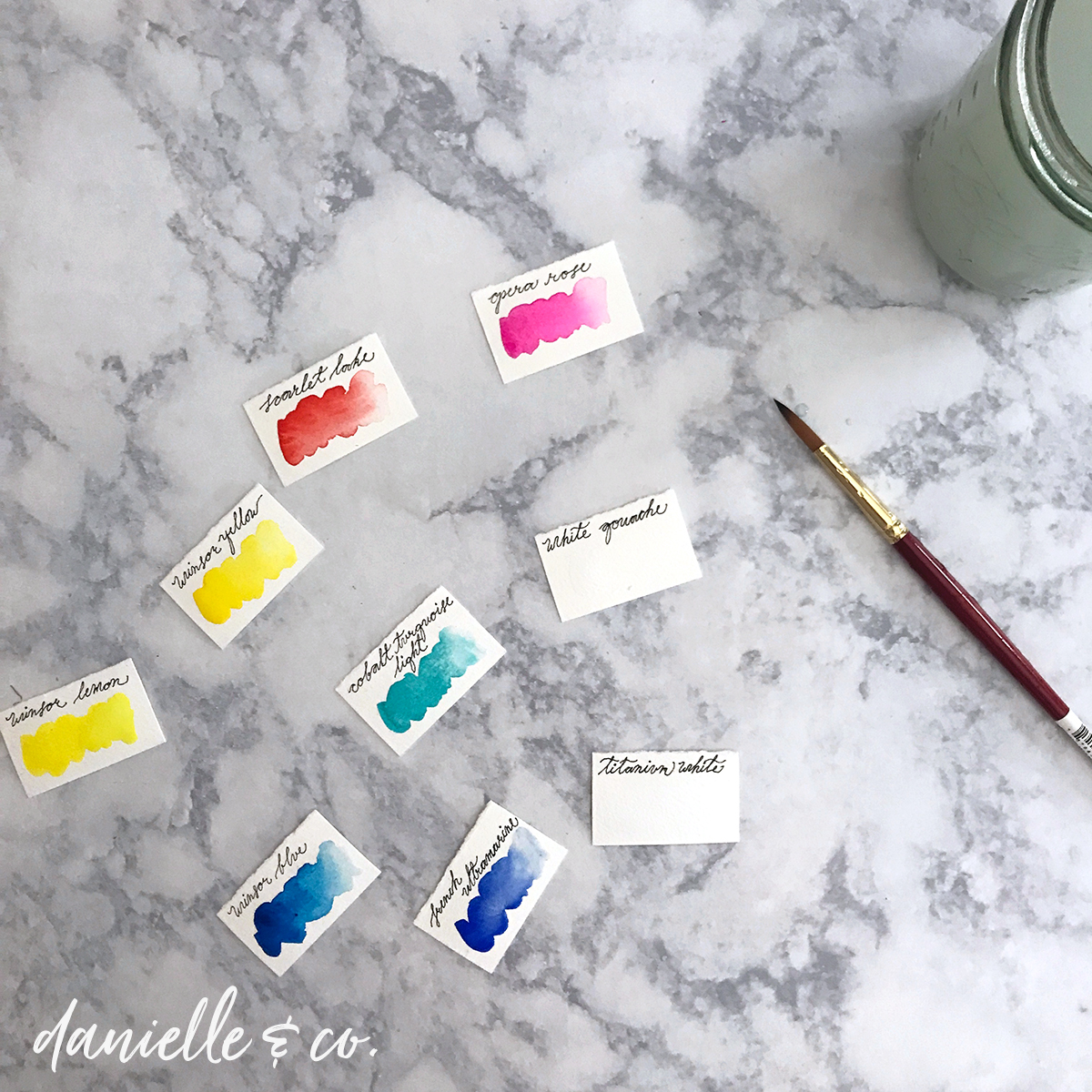 Creating watercolor paint swatches, for a DIY watercolor paint storage board. From danielleandco.com
