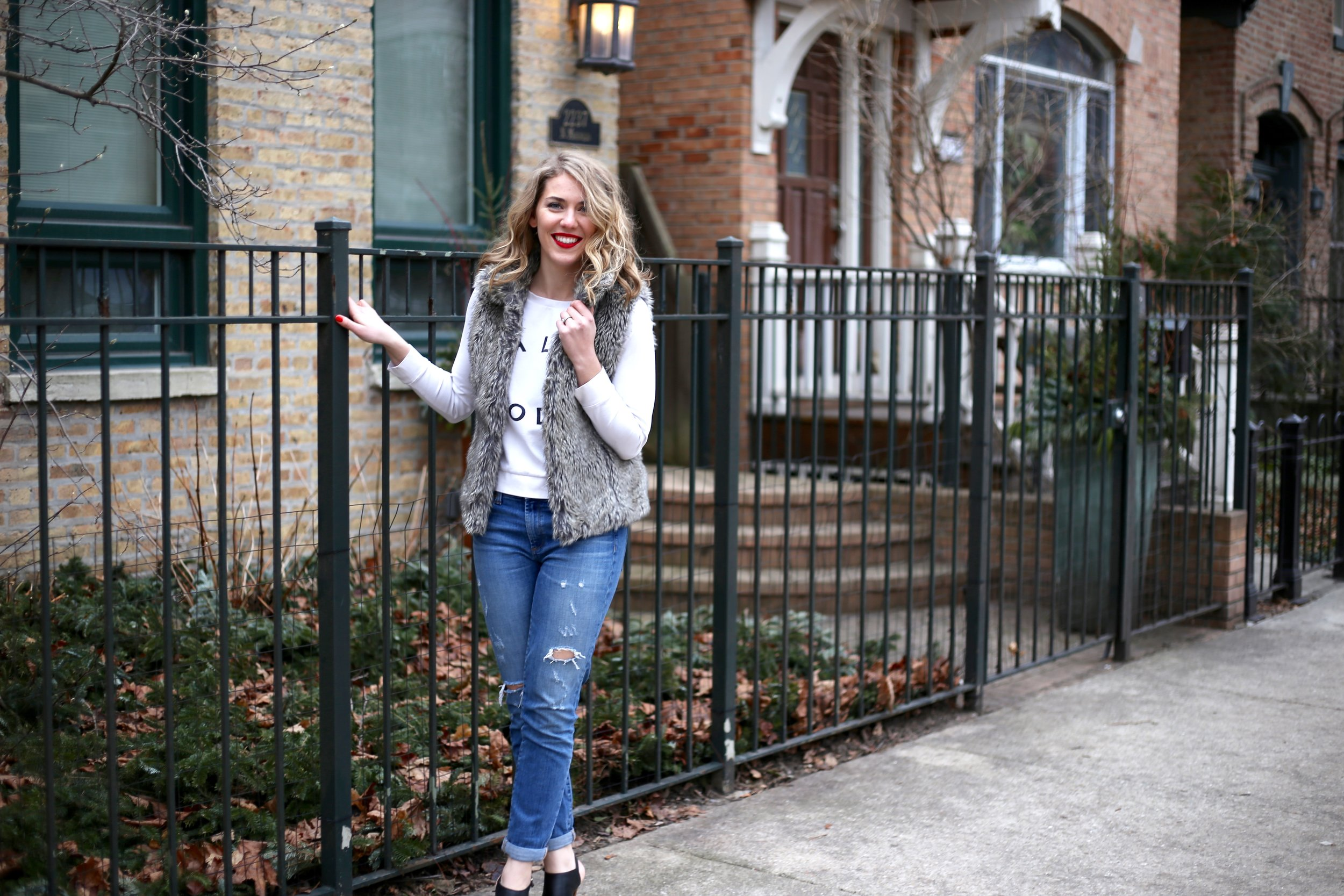 A red lip paired with a casual sweatshirt + boyfriend jeans? Instant outfit-maker