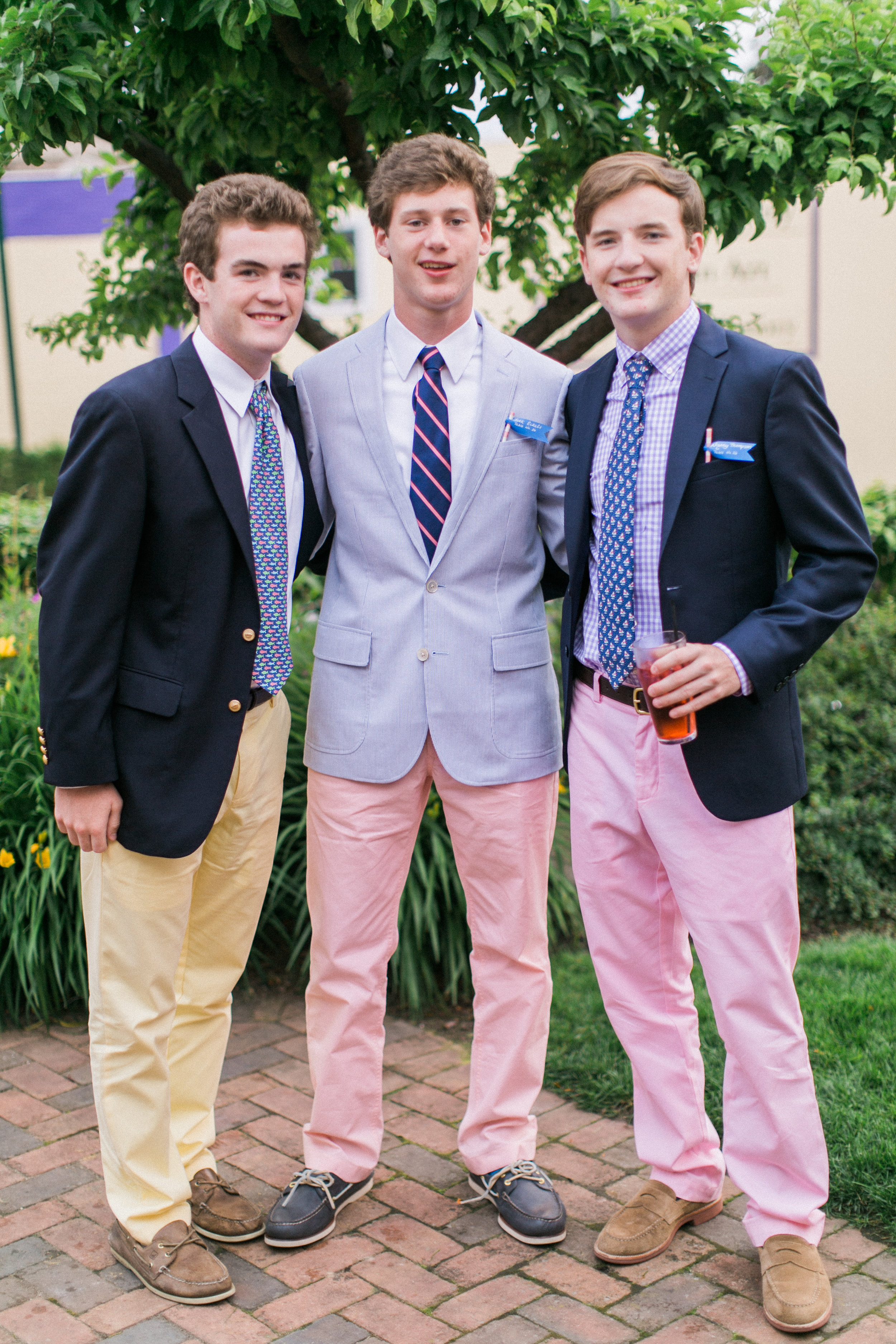 Three male models—I mean, my cousins—sporting the unofficial attire