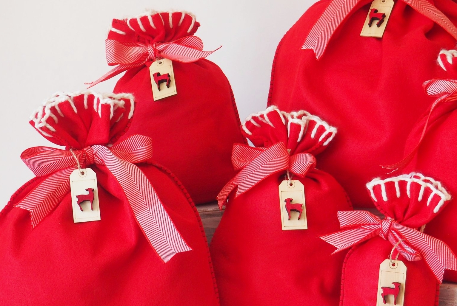 Every bag has matching ribbons. - There is a ribbon guide on the back of the bags to help the ribbon stay in place as it gathers around the fabric.