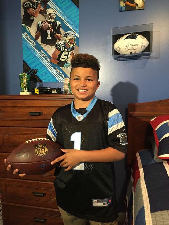jaden with both footballs.jpg
