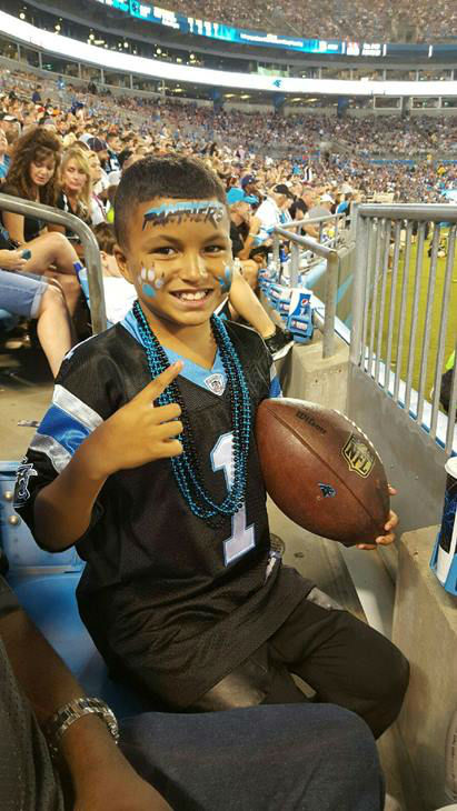 jaden with game ball.jpg