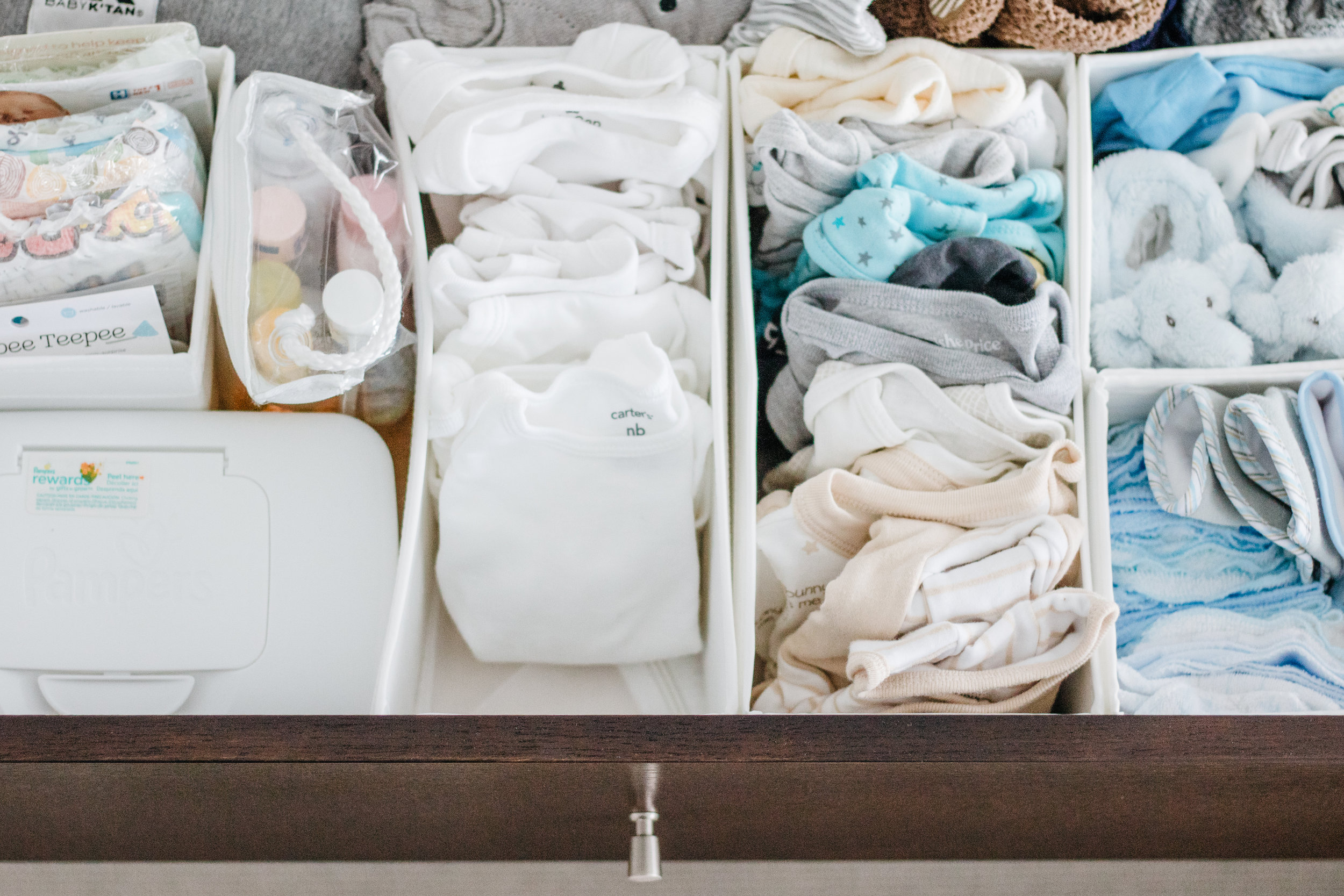 What's in the drawer: Diapering & Showering needs . Baby wrap . Wash cloths . Bibs . Socks . Hats . Mittens .Clothes