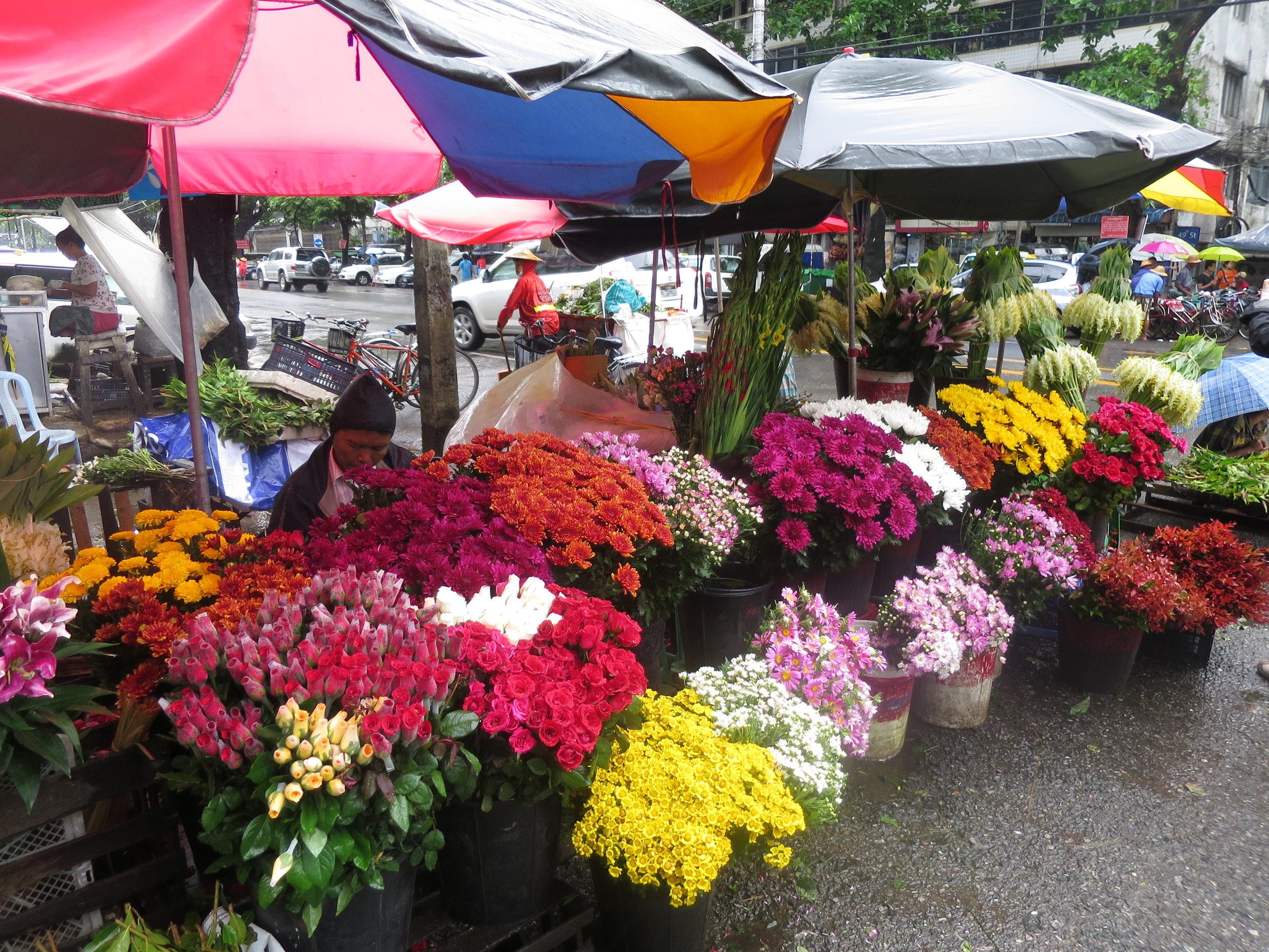 Fabulous flower stalls in Rangoon shine however much mist and monsoon rain tumble down!