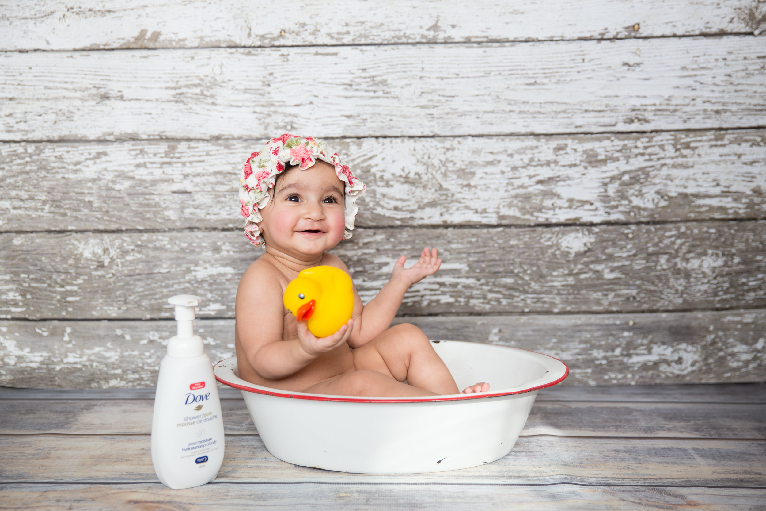 Cute baby girl in a bathtub photo session. Milestone Photoshoot of a Calgary baby girl