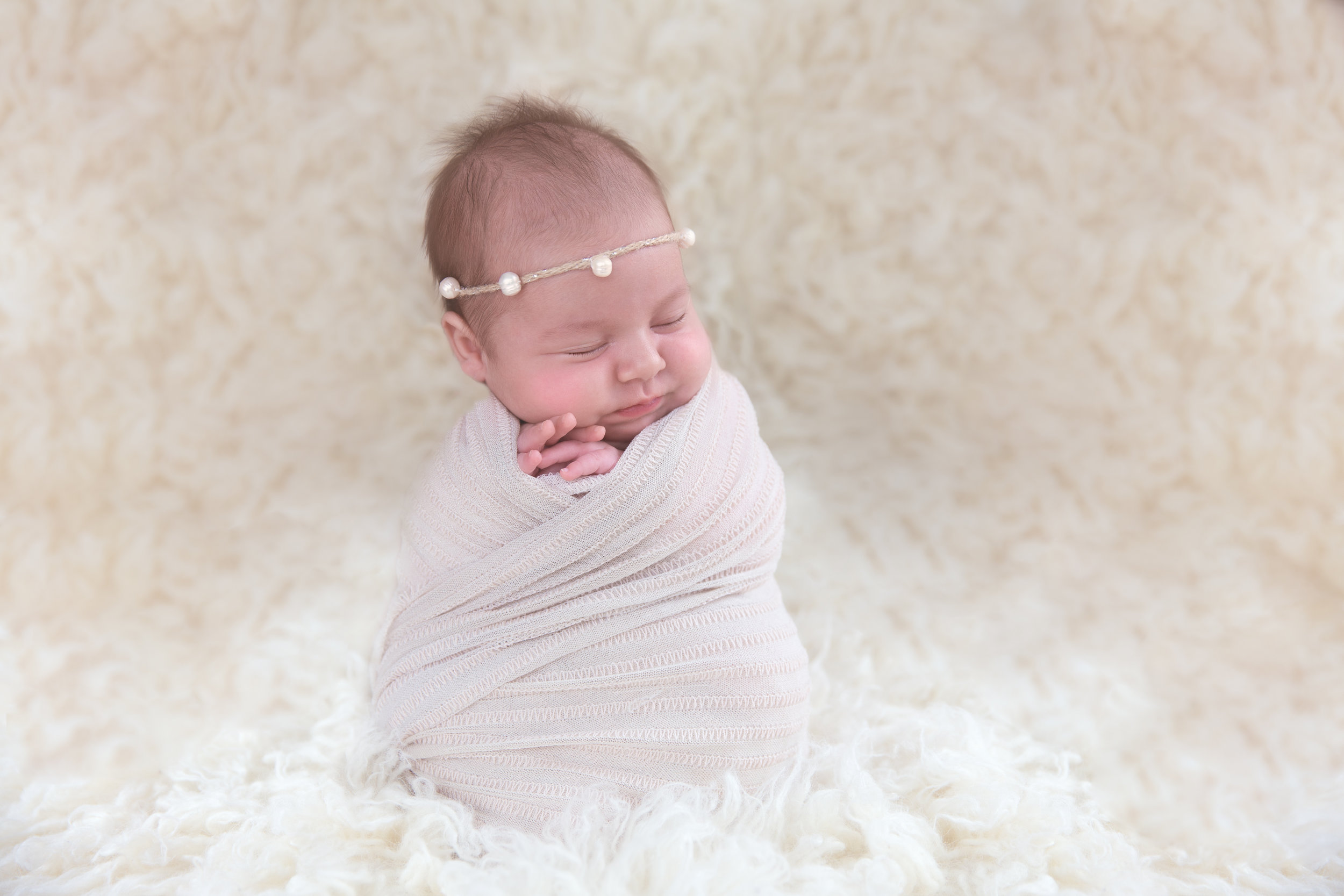 Potato sack pose during Newborn shoot for a baby girl. Calgary Newborn Photographer.