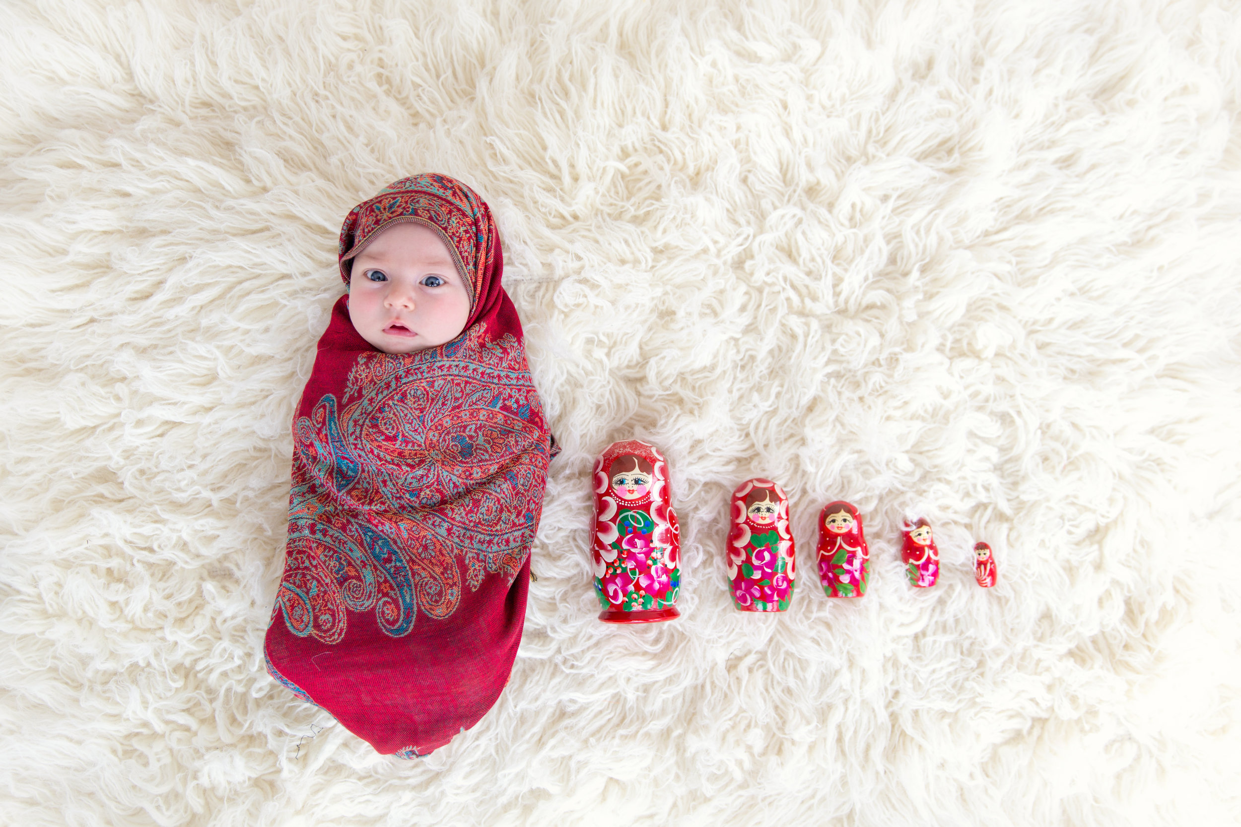 Matryoshka or Russian doll, Baby girl as Matryoshka during her Newborn photoshoot. Calgary Newborn photographer.