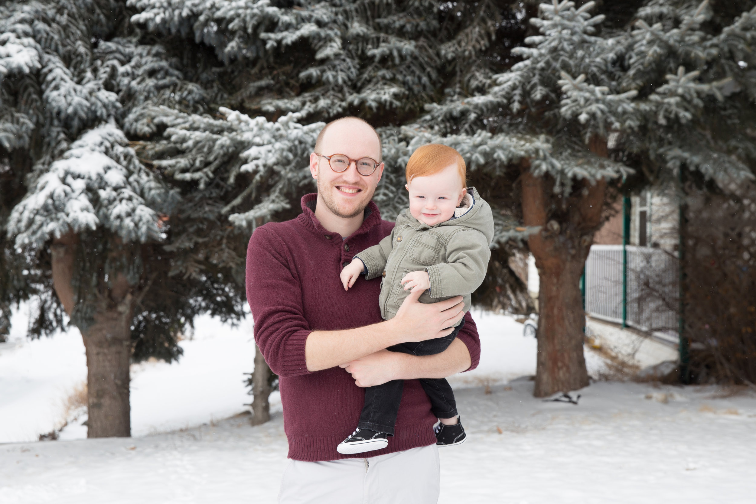 Sweet little redhead boy with his dad. Calgary photographer.