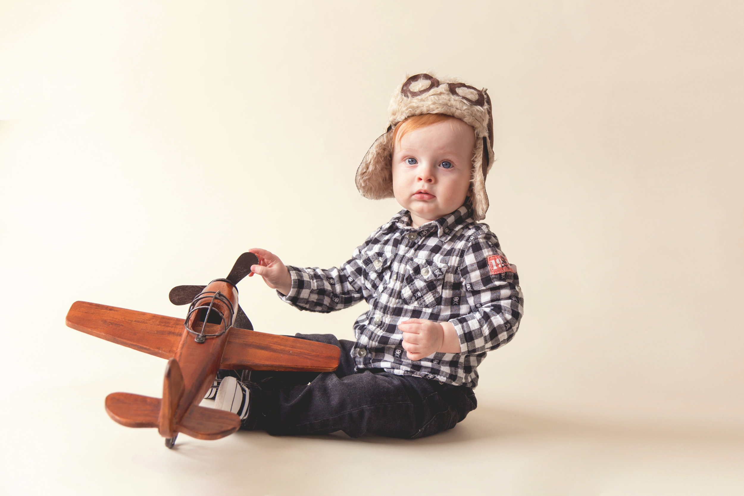 Boy and a wooden plane. Aviator. Airdrie and Calgary child photographer.